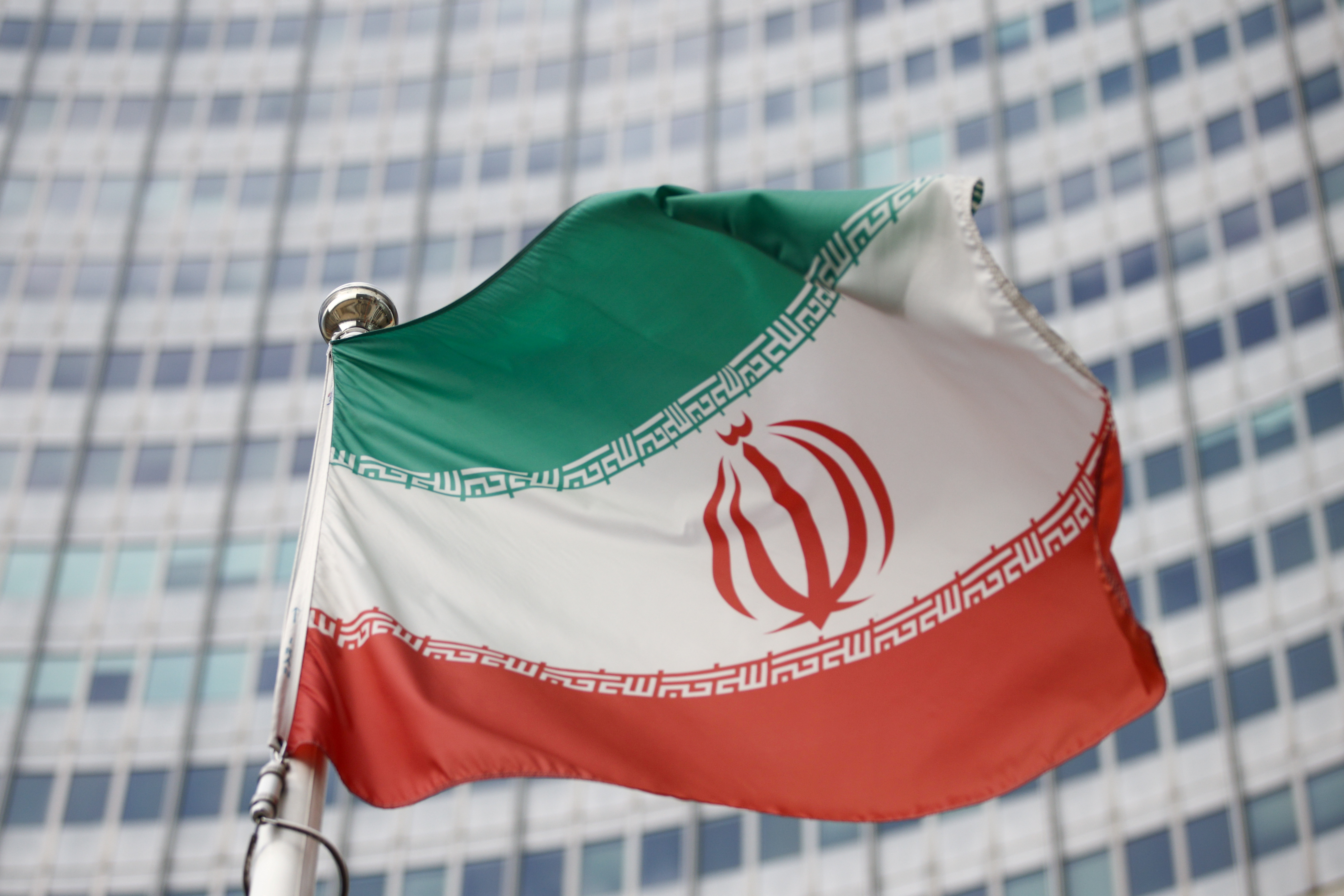 The Iranian flag waves in front of the International Atomic Energy Agency (IAEA) headquarters, before the beginning of a board of governors meeting, amid the coronavirus disease (COVID-19) outbreak in Vienna, Austria, March 1, 2021. REUTERS/Lisi Niesner