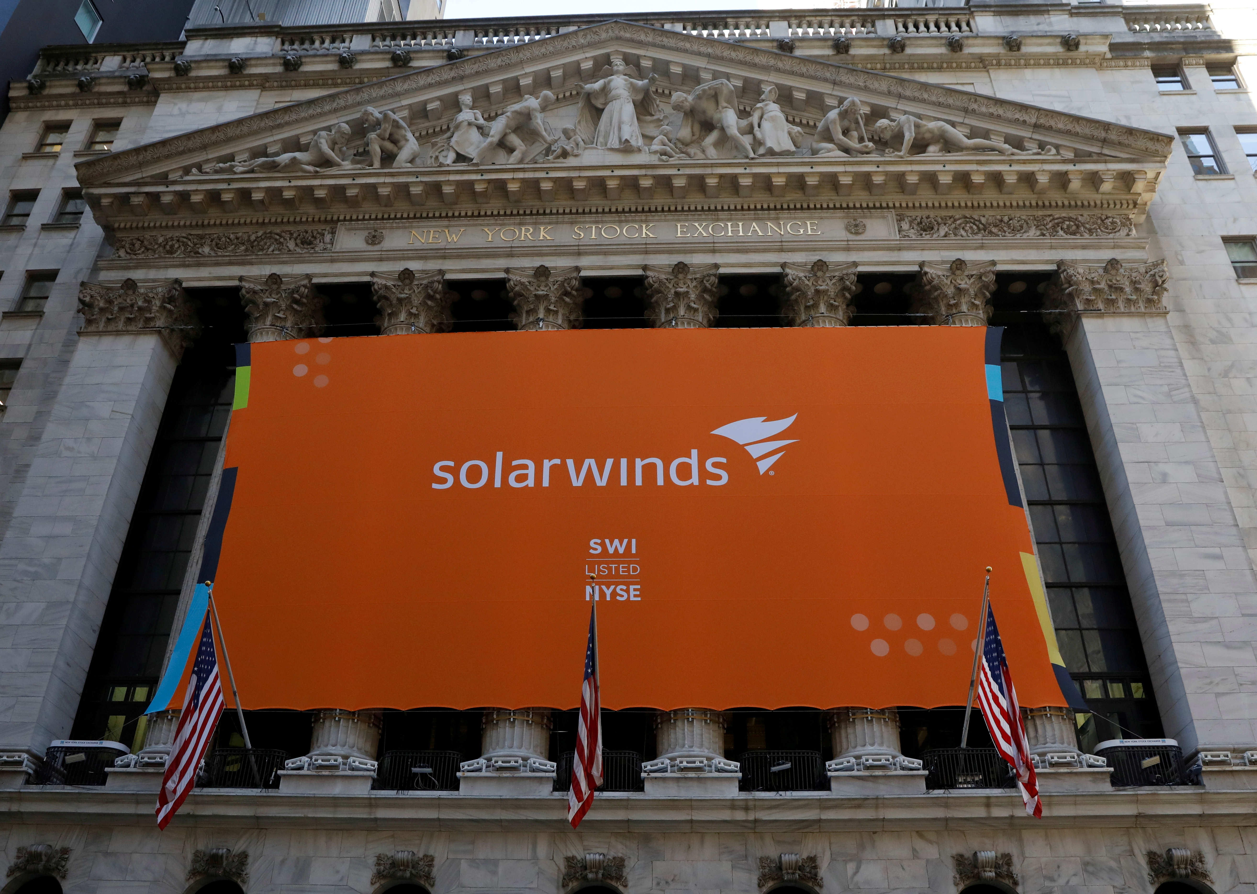 SolarWinds Corp banner hangs at the New York Stock Exchange (NYSE) on the IPO day of the company in New York, U.S., October 19, 2018. REUTERS/Brendan McDermid/File Photo