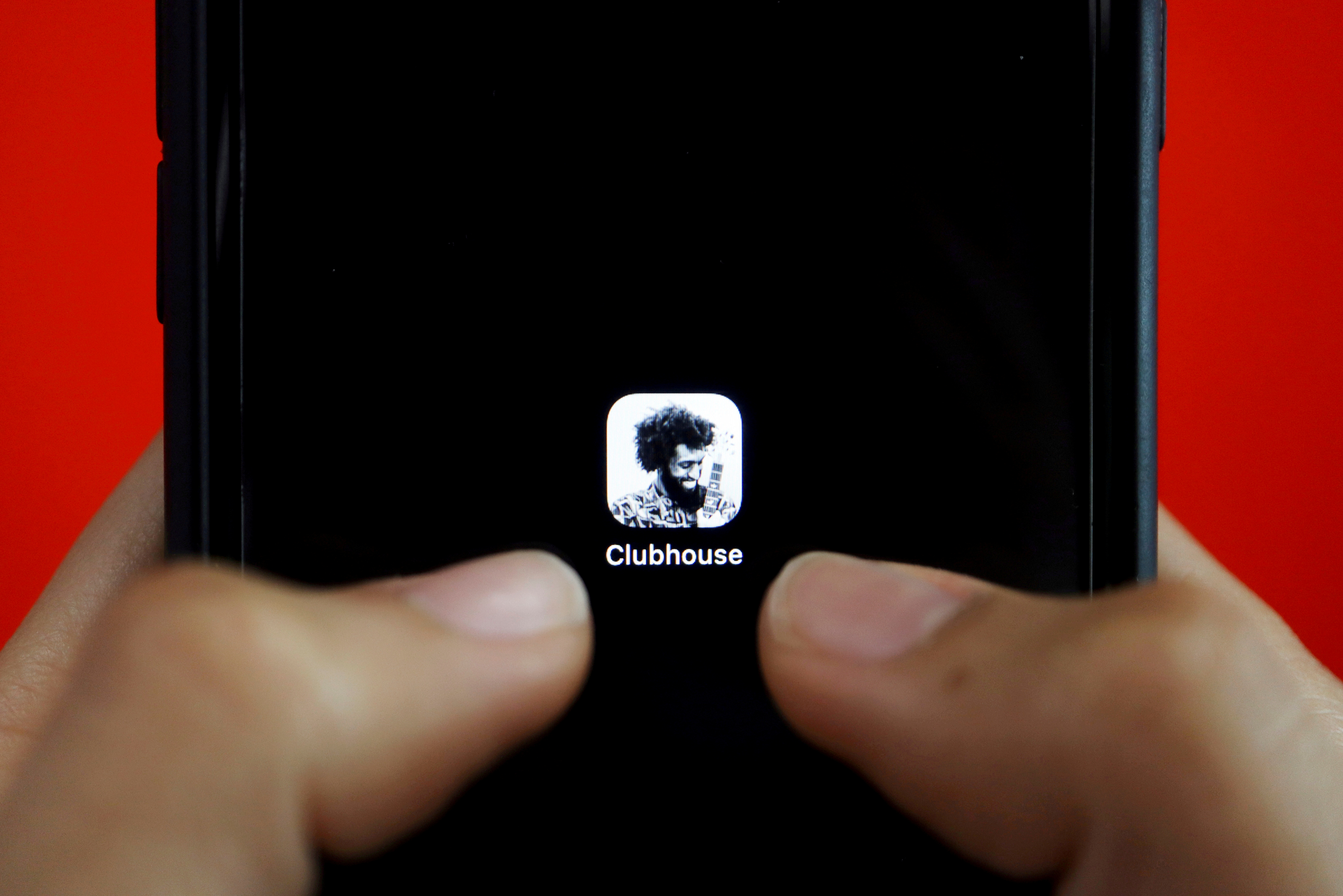 The social audio app Clubhouse is seen on a mobile phone in this illustration picture taken February 8, 2021. REUTERS/Florence Lo/Illustration/File Photo