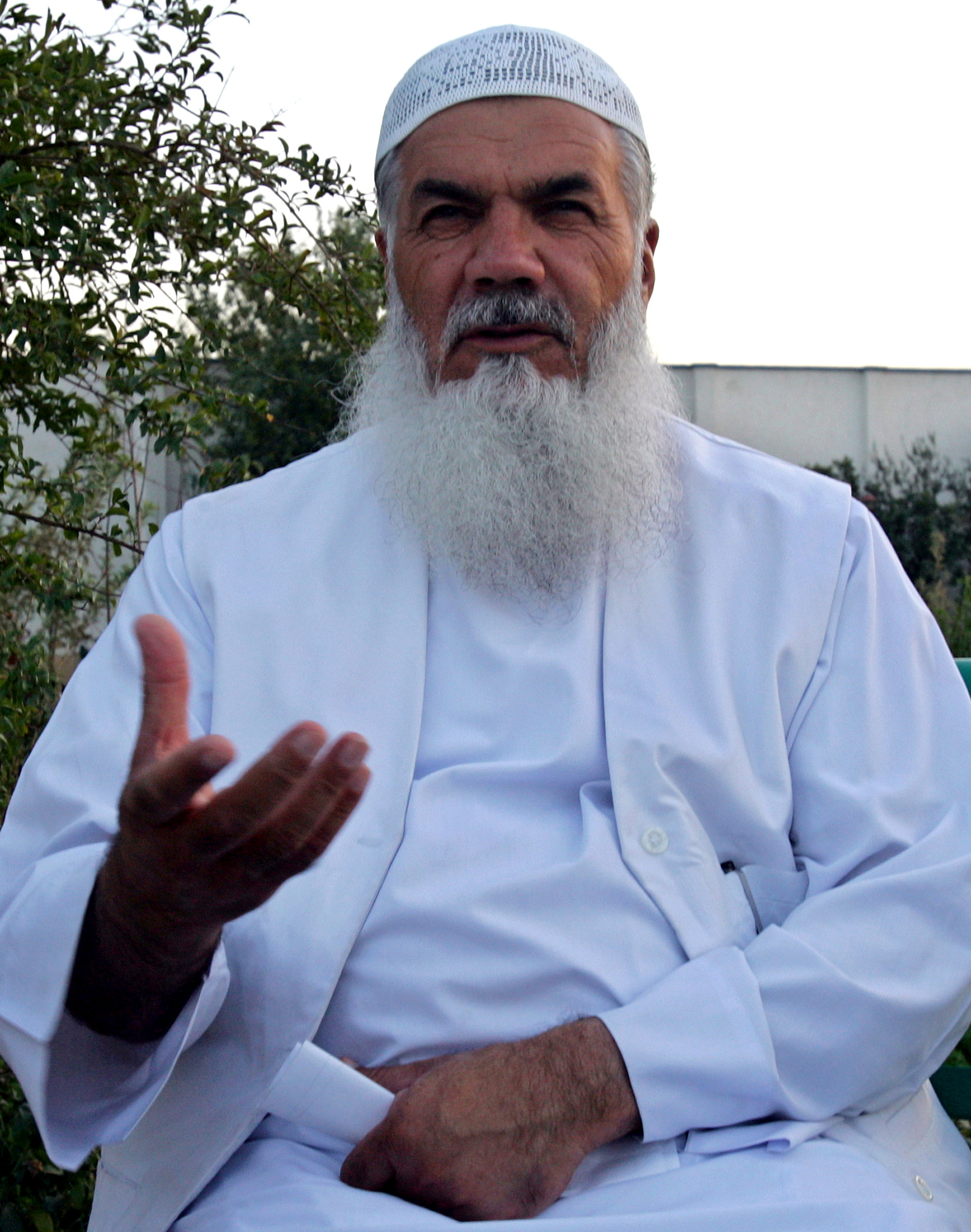 Ismail Khan, the militia commander and former governor of the western Afghan city of Herat, speaks during an interview with Reuters at his Herat residence, September 29, 2004. Ahmad Masood/REUTERS/File Photo