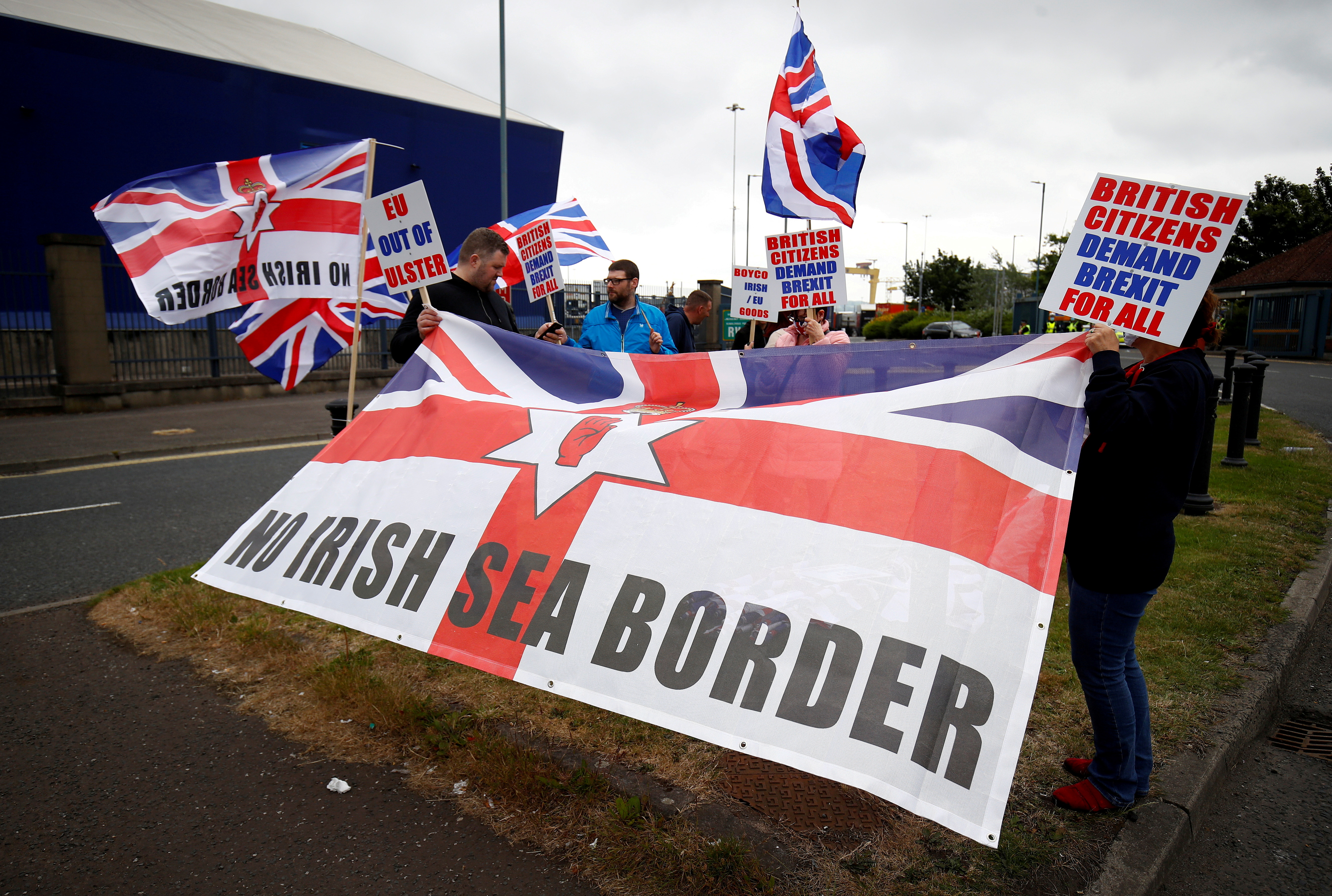 Loyalists protest against the Northern Ireland Brexit protocol at Belfast Harbour Estate, in Belfast, Northern Ireland, July 3, 2021. REUTERS/Jason Cairnduff