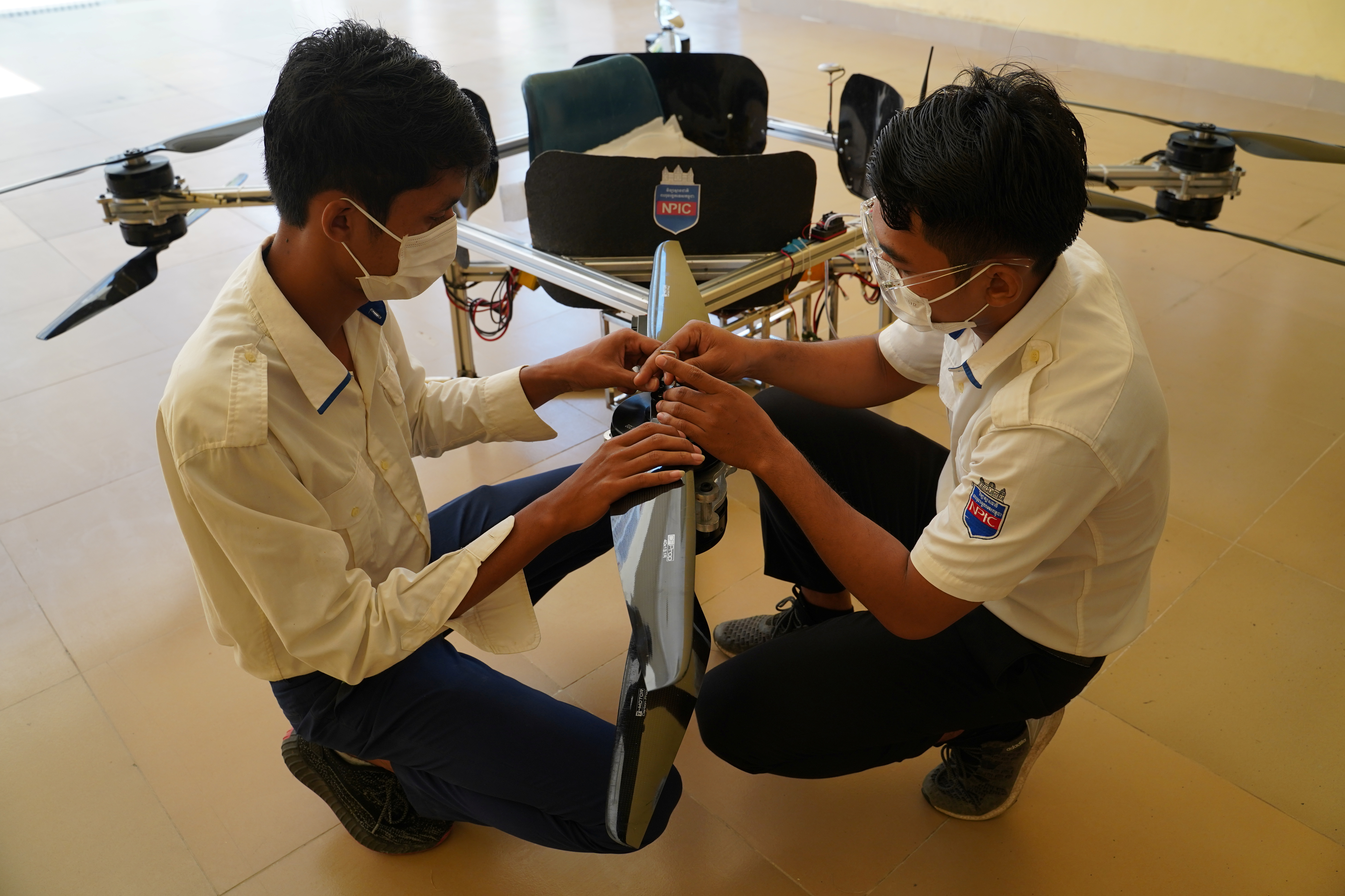Students of the National Polytechnic Institute of Cambodia prepare their manned drone for flight, in Phnom Penh, Cambodia, September 17, 2021. REUTERS/Cindy Liu