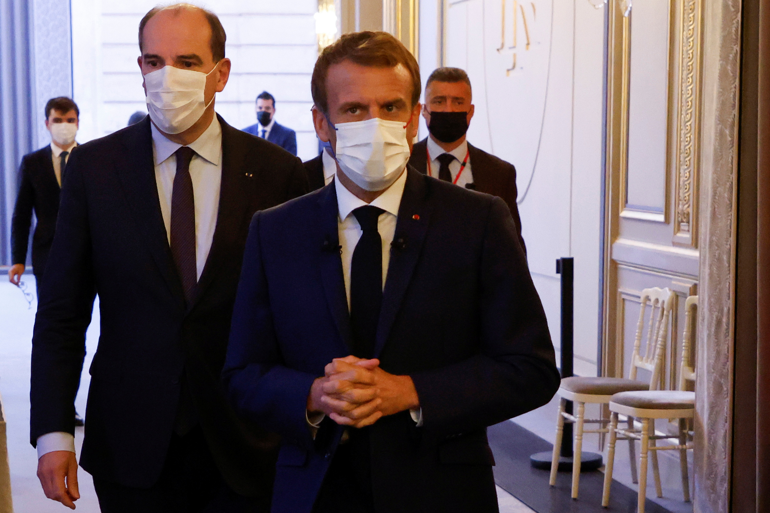 French Prime Minister Jean Castex and French President Emmanuel Macron arrive for the presentation of the