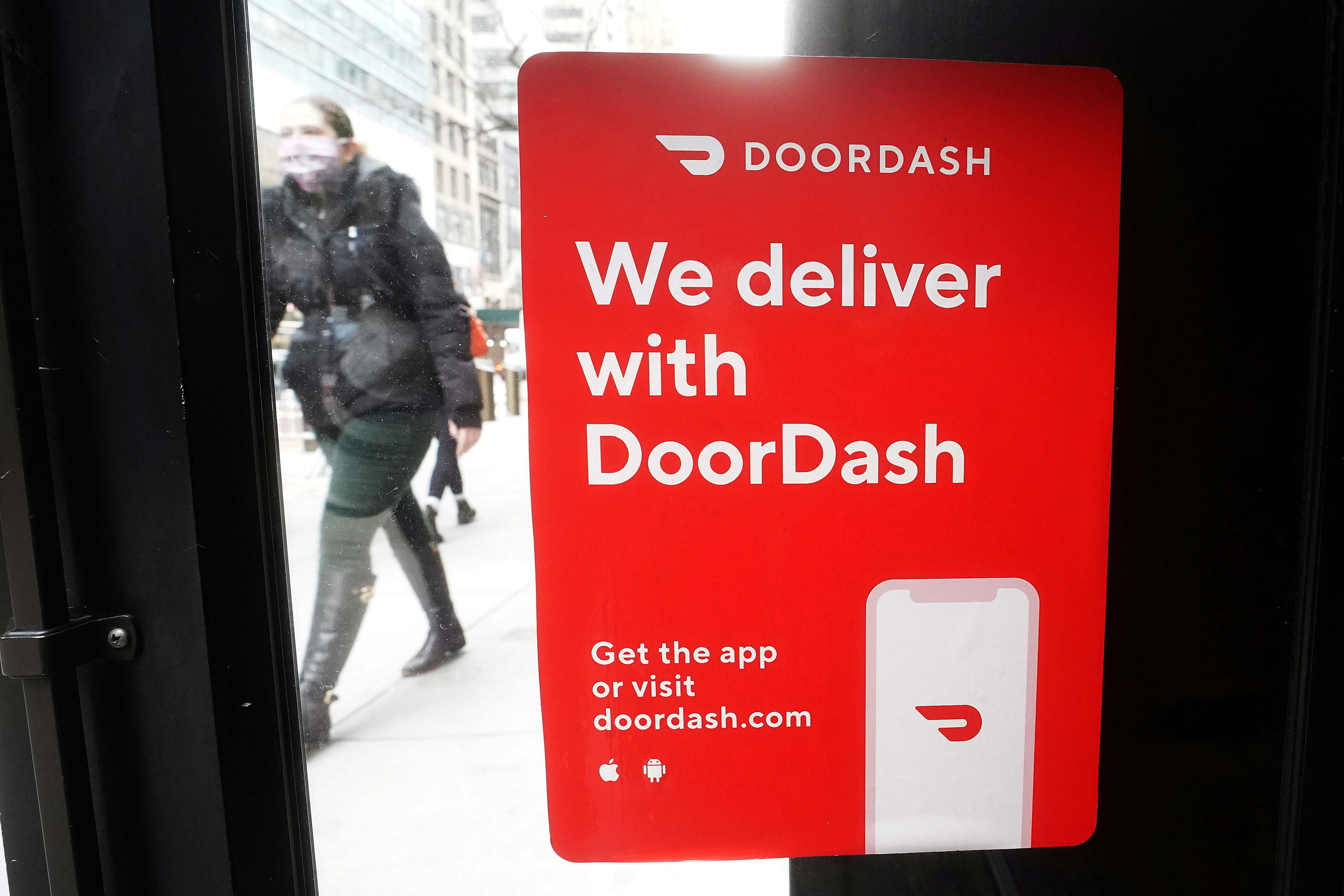 FILE PHOTO: A DoorDash sign is pictured on a restaurant in the Manhattan borough of New York City, New York, U.S., December 9, 2020. REUTERS/Carlo Allegri