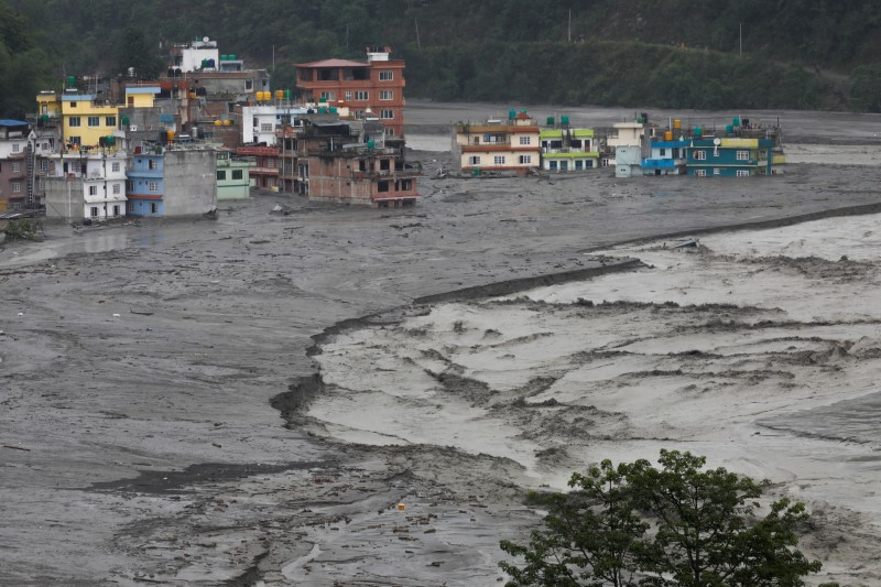 A general view shows houses hit by flash floods along the bank of Melamchi River in Sindhupalchok, Nepal June 16, 2021. REUTERS/Navesh Chitrakar