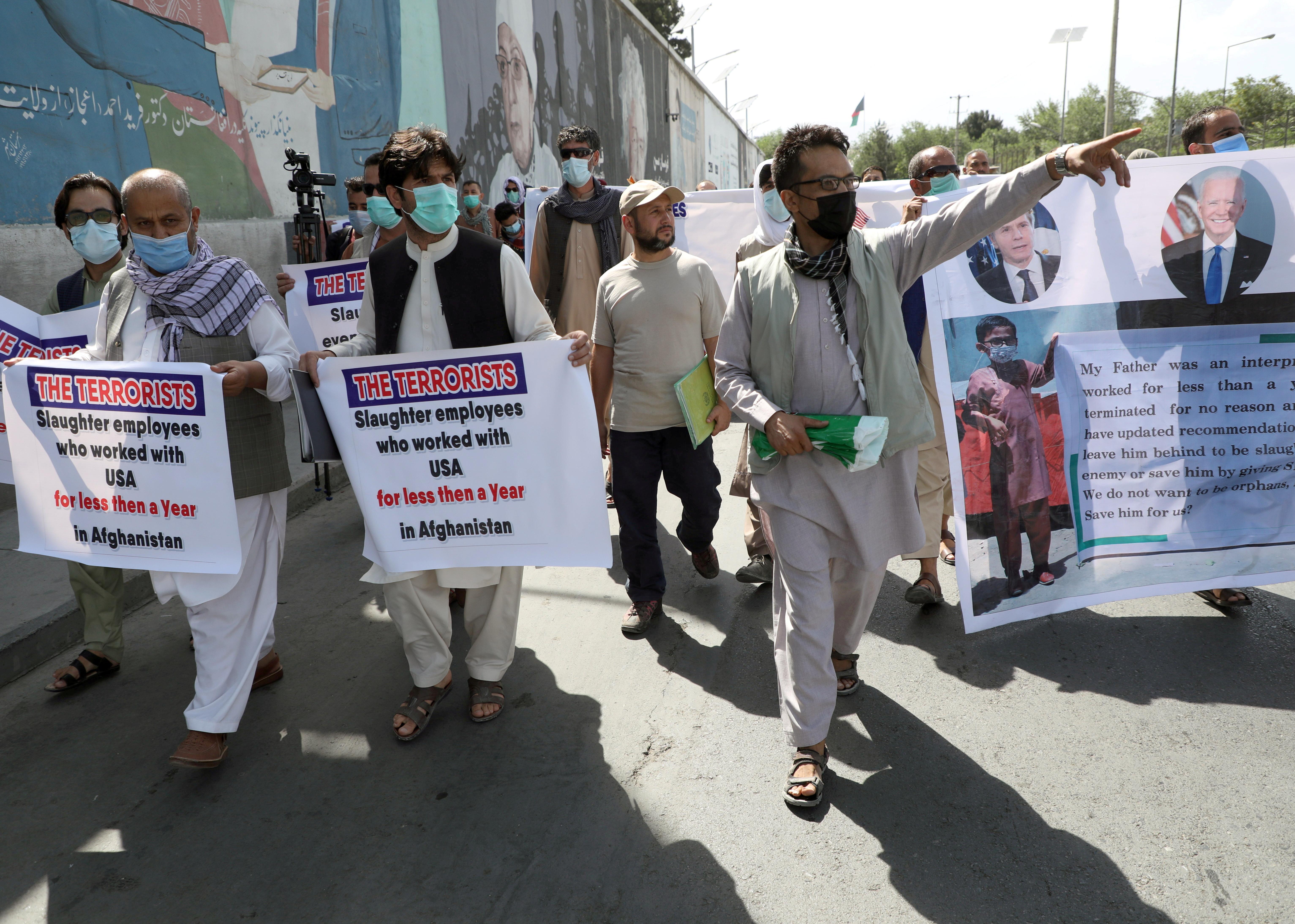 Former Afghan interpreters, who worked with U.S. troops in Afghanistan, demonstrate in front of the U.S. embassy in Kabul June 25, 2021. REUTERS/Stringer/File Photo