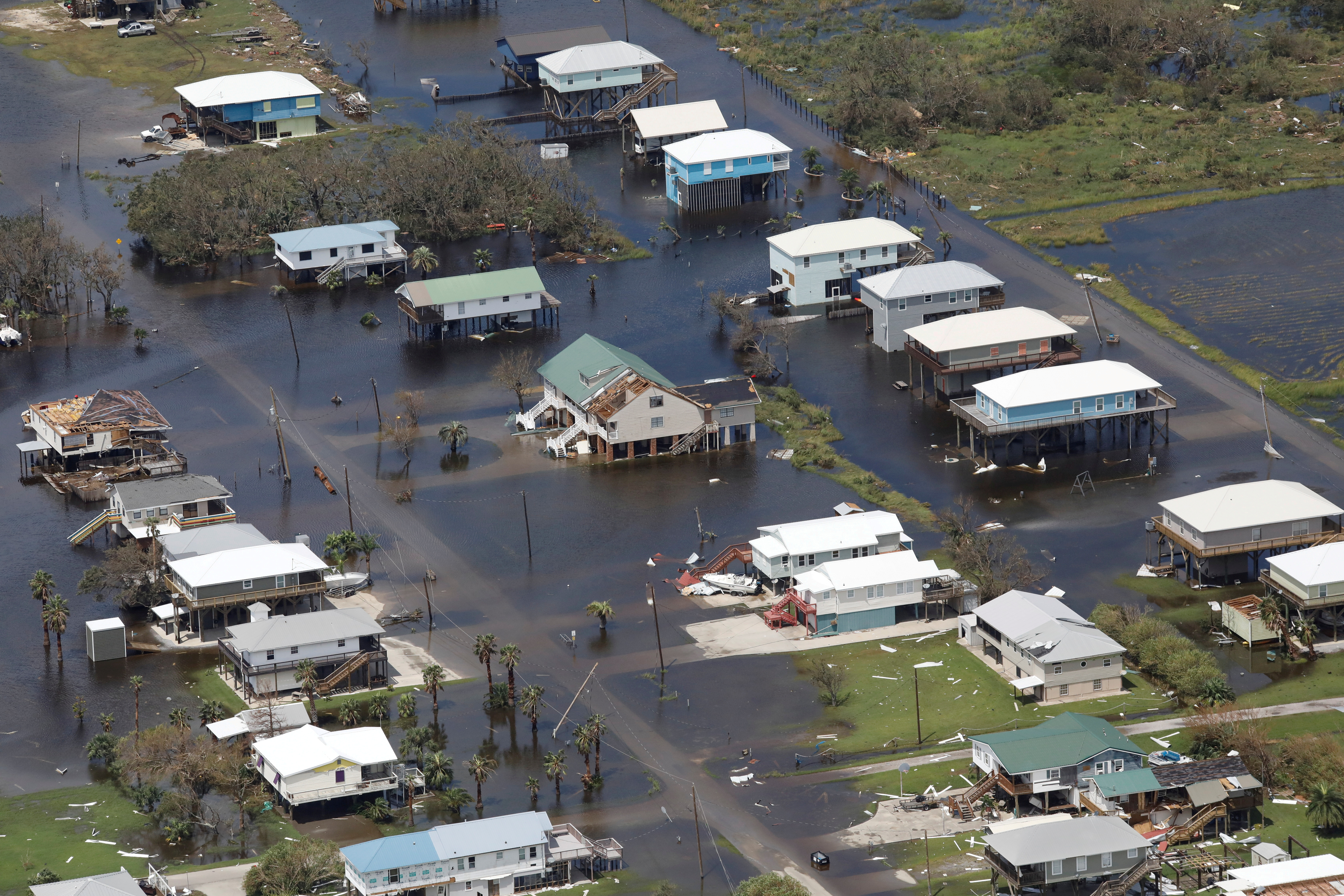 An aerial view shows destroyed houses in a flooded area after Hurricane Ida hit Grand Isle, Louisiana, August 31, 2021. REUTERS/Marco Bello/File Photo