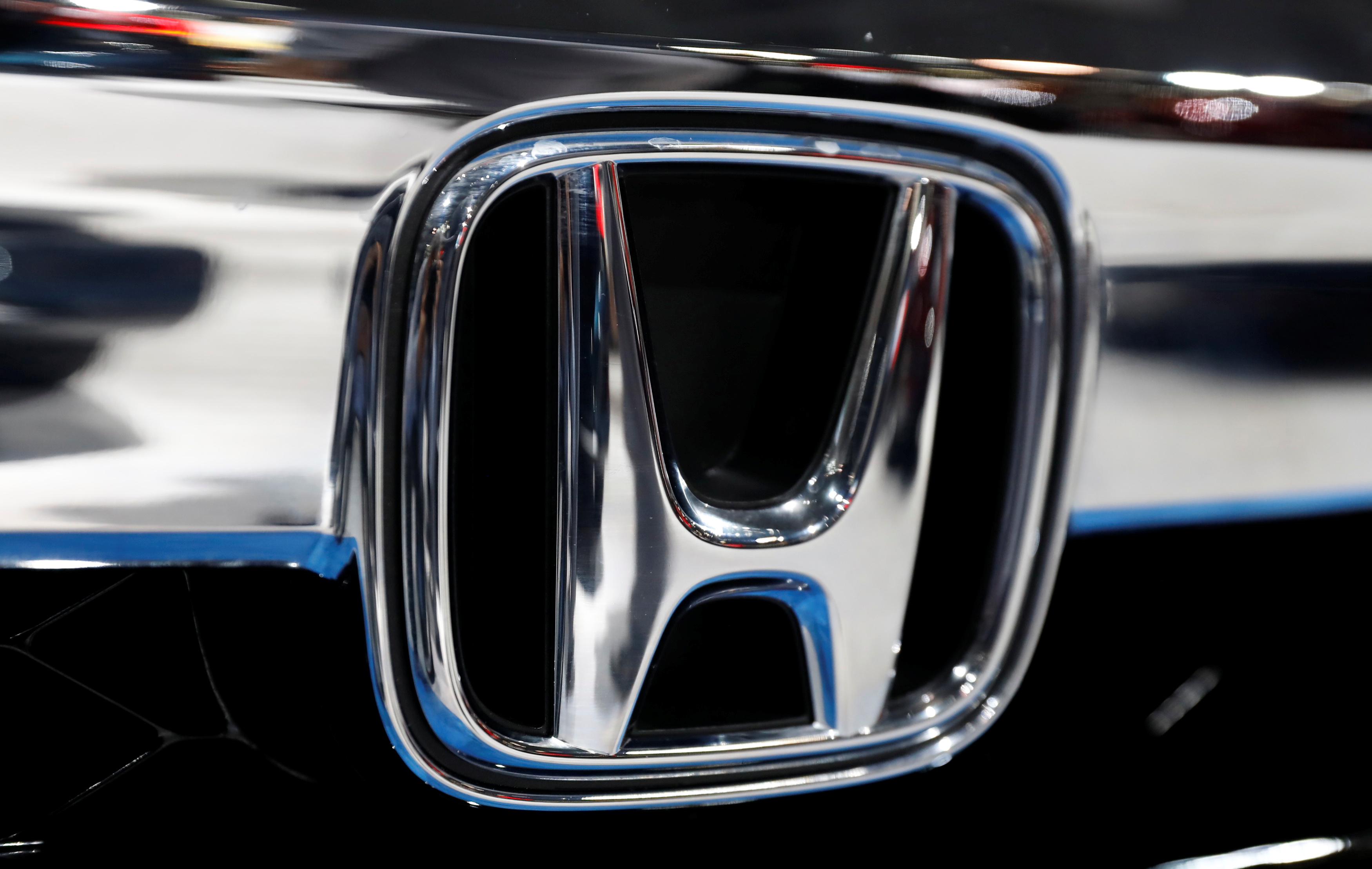 The Honda logo is seen on a Honda car displayed at the New York Auto Show in the Manhattan borough of New York City, New York, U.S., March 29, 2018. REUTERS/Shannon Stapleton/File Photo