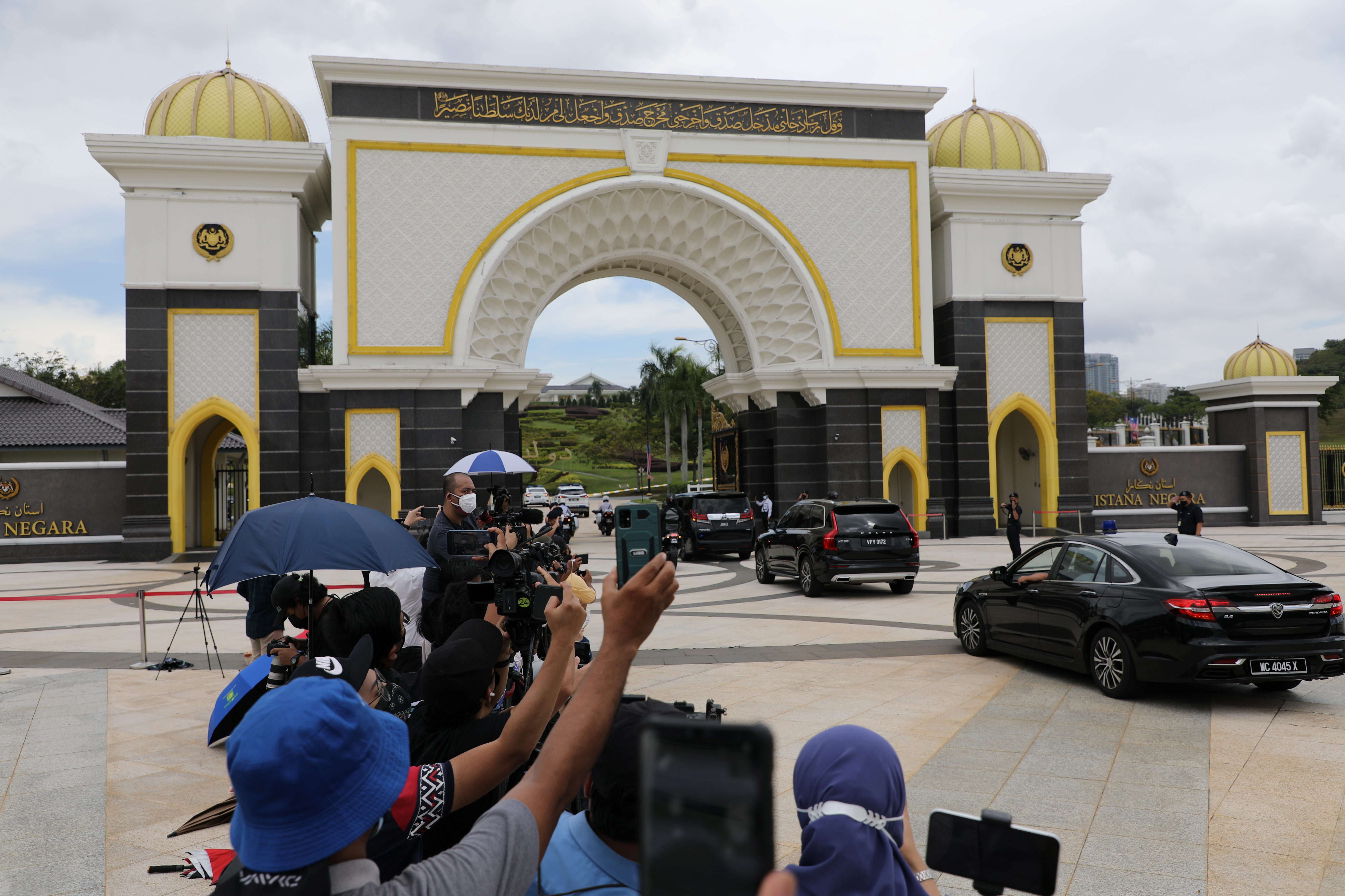 A convoy with Malaysian Prime Minister Muhyiddin Yassin arrives at the National Palace for his meeting with the king, in Kuala Lumpur, Malaysia August 16, 2021. REUTERS/Lim Huey Teng