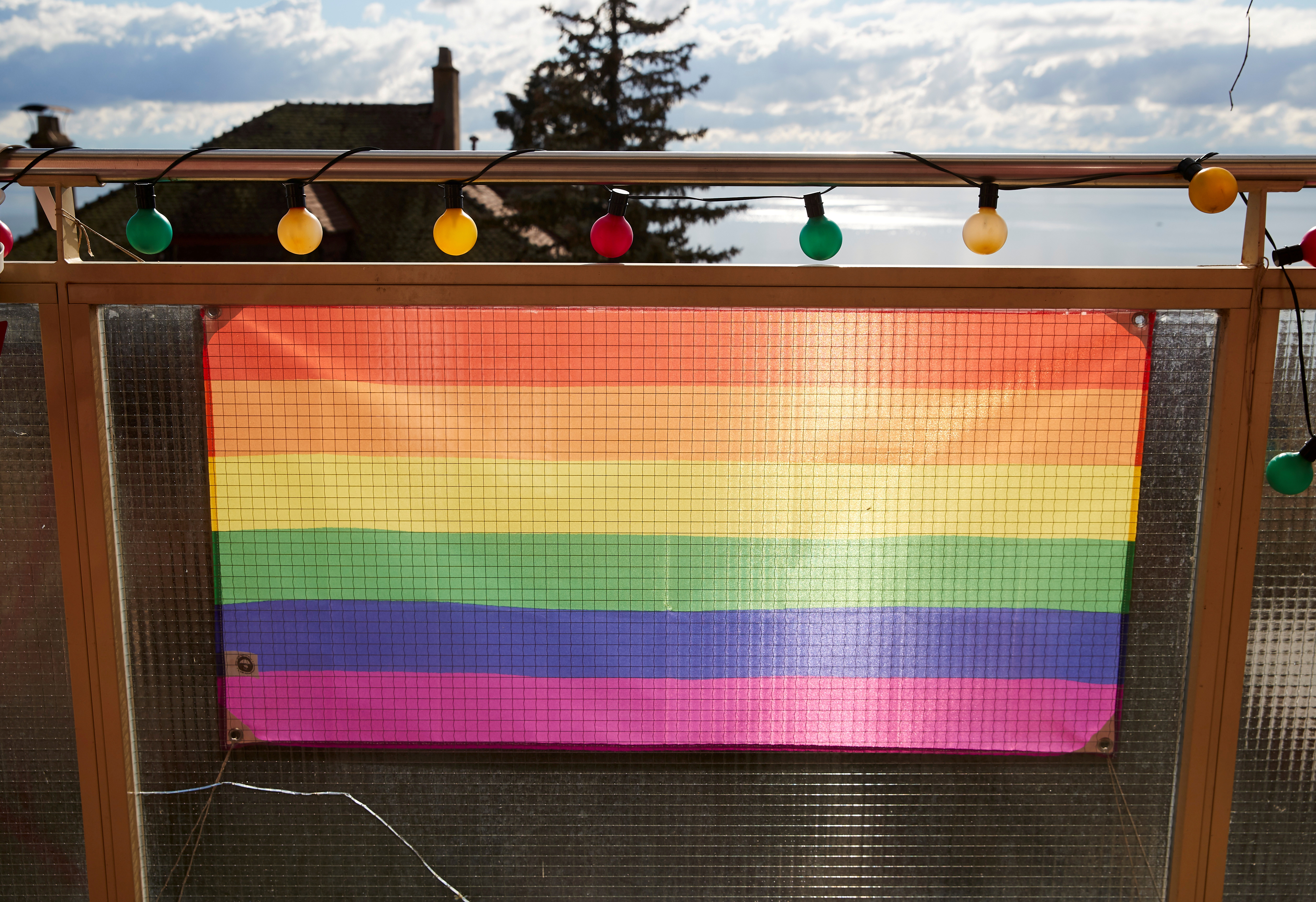 A rainbow flag is pictured on a balcony ahead of a referendum on anti-homophobia law, in Neuchatel, Switzerland, February 5, 2020.   Picture taken February 5, 2020. REUTERS/Denis Balibouse/File Photo
