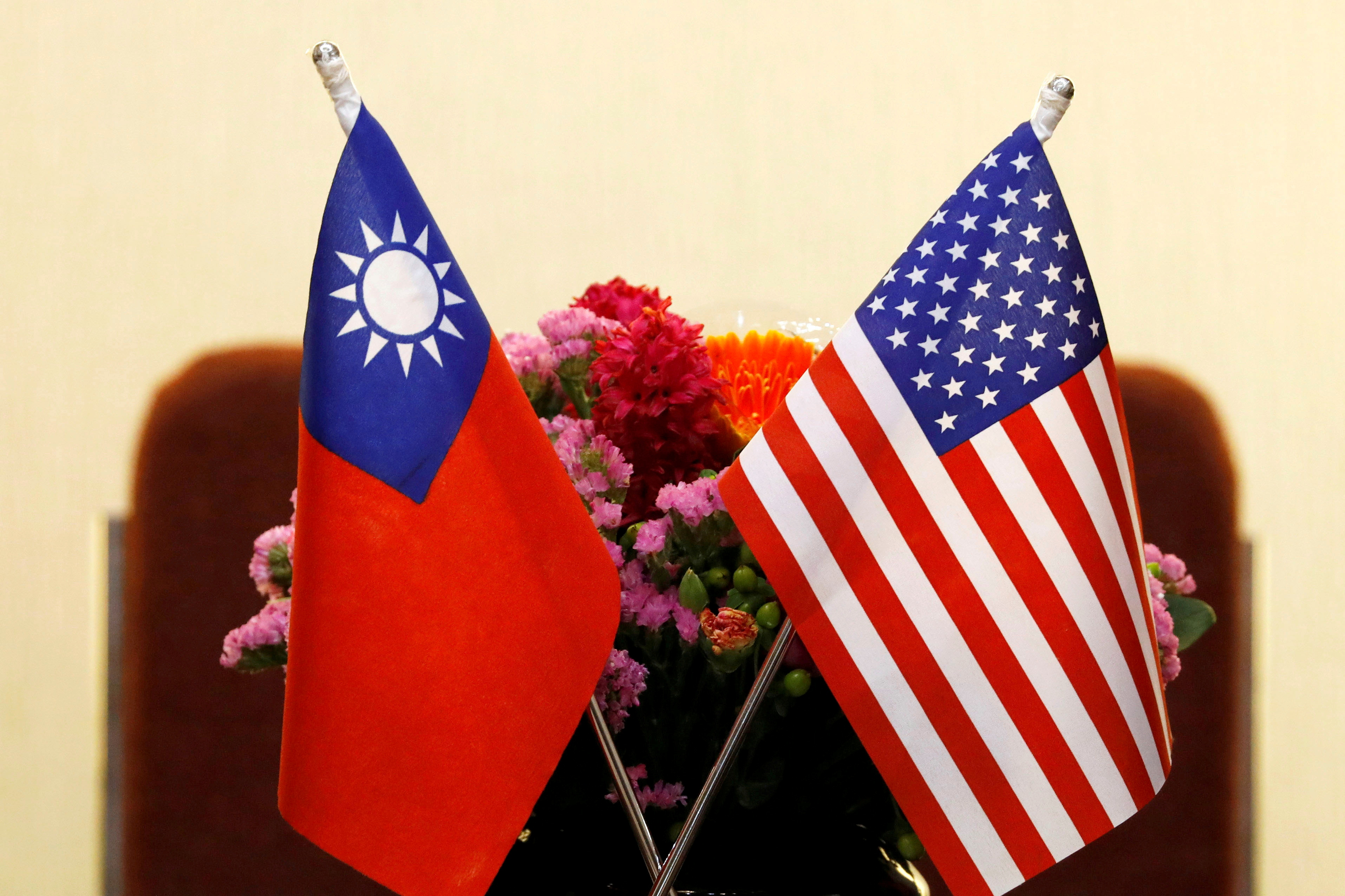 Flags of Taiwan and U.S. are placed for a meeting in Taipei, Taiwan March 27, 2018. REUTERS/Tyrone Siu