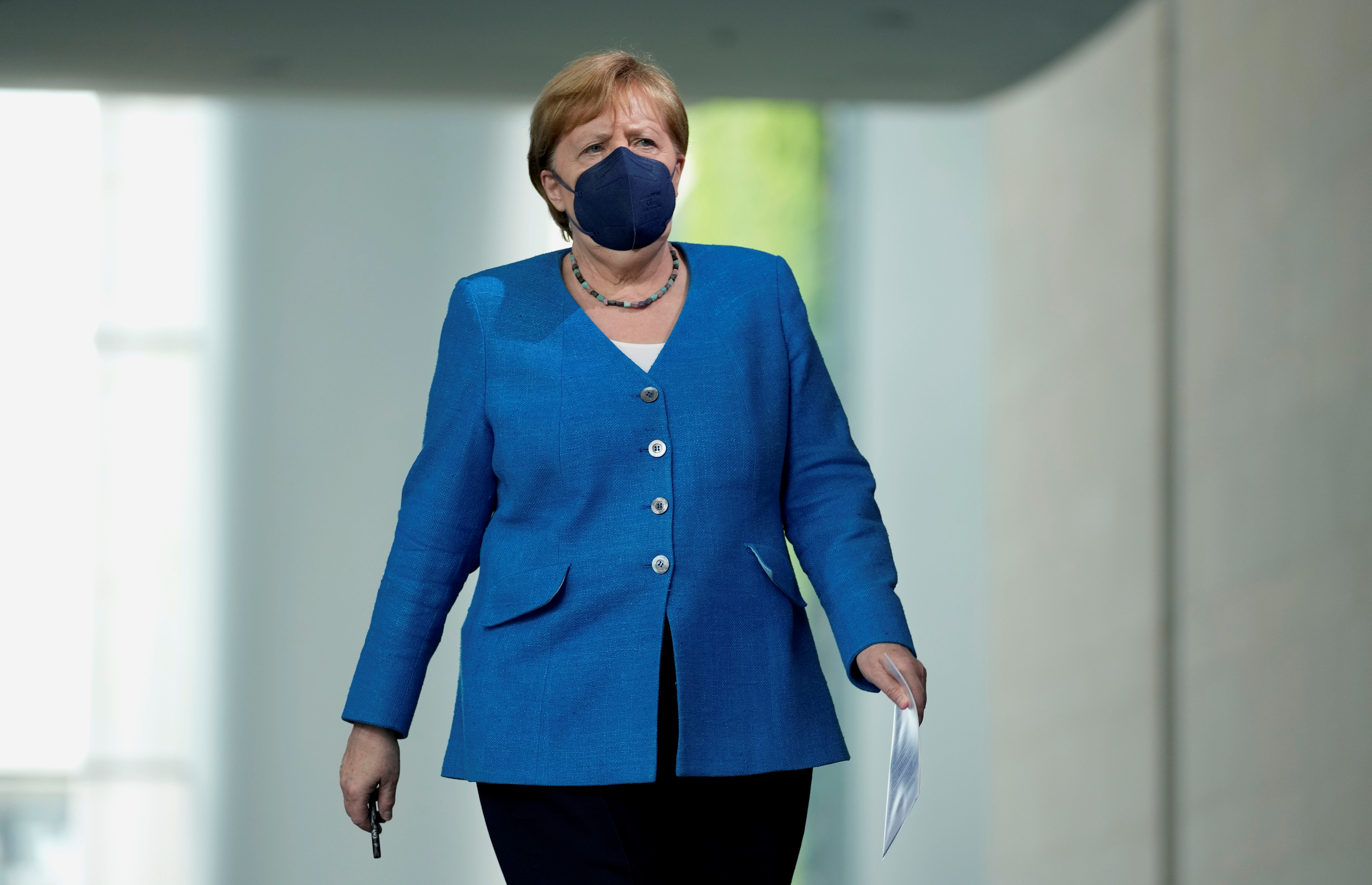 German Chancellor Angela Merkel arrives for a news conference following a virtual