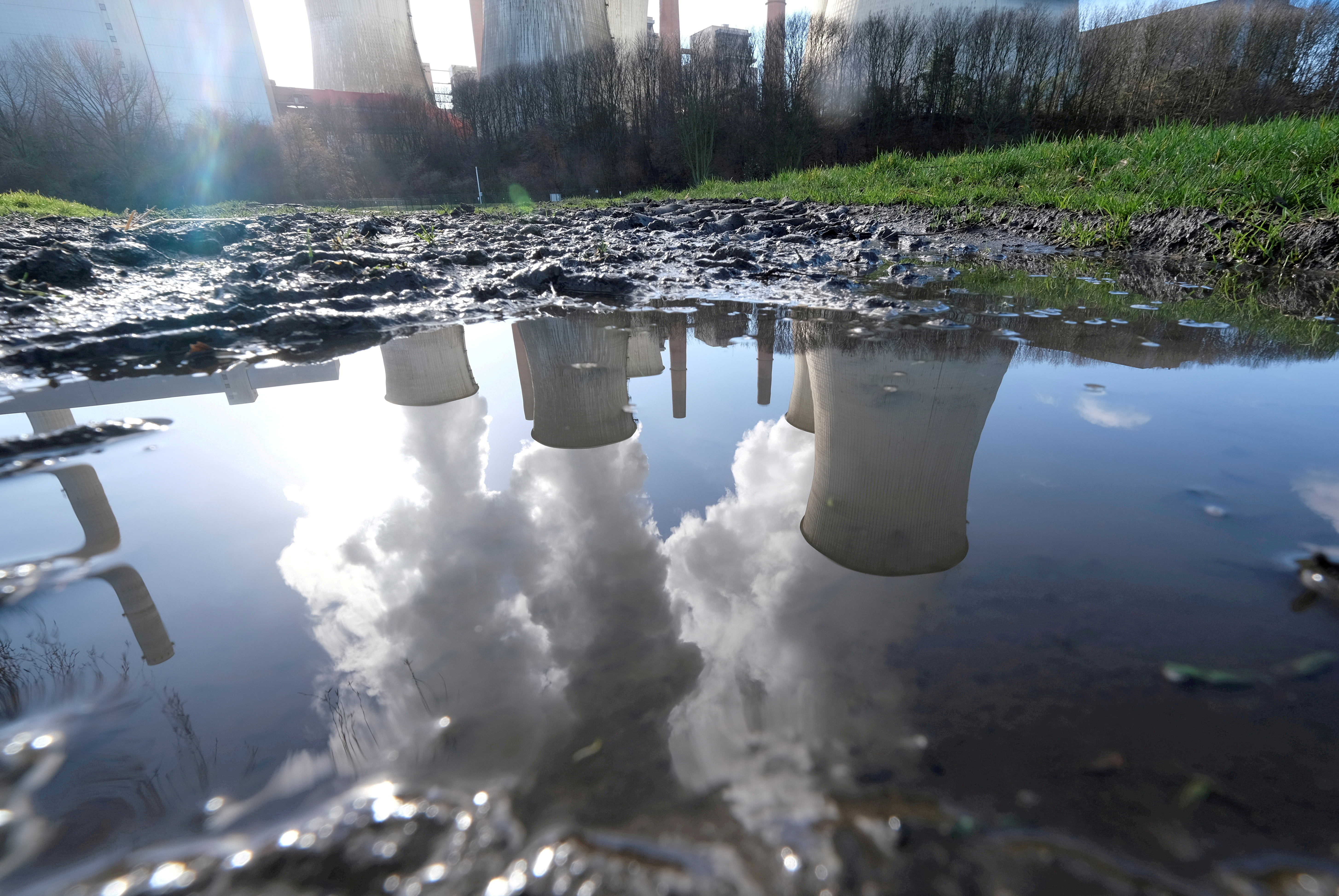 The lignite (brown coal) power plant complex of German energy supplier and utility RWE is reflected in a large puddle in Neurath, northwest of Cologne, Germany, February 5, 2020.    REUTERS/Wolfgang Rattay