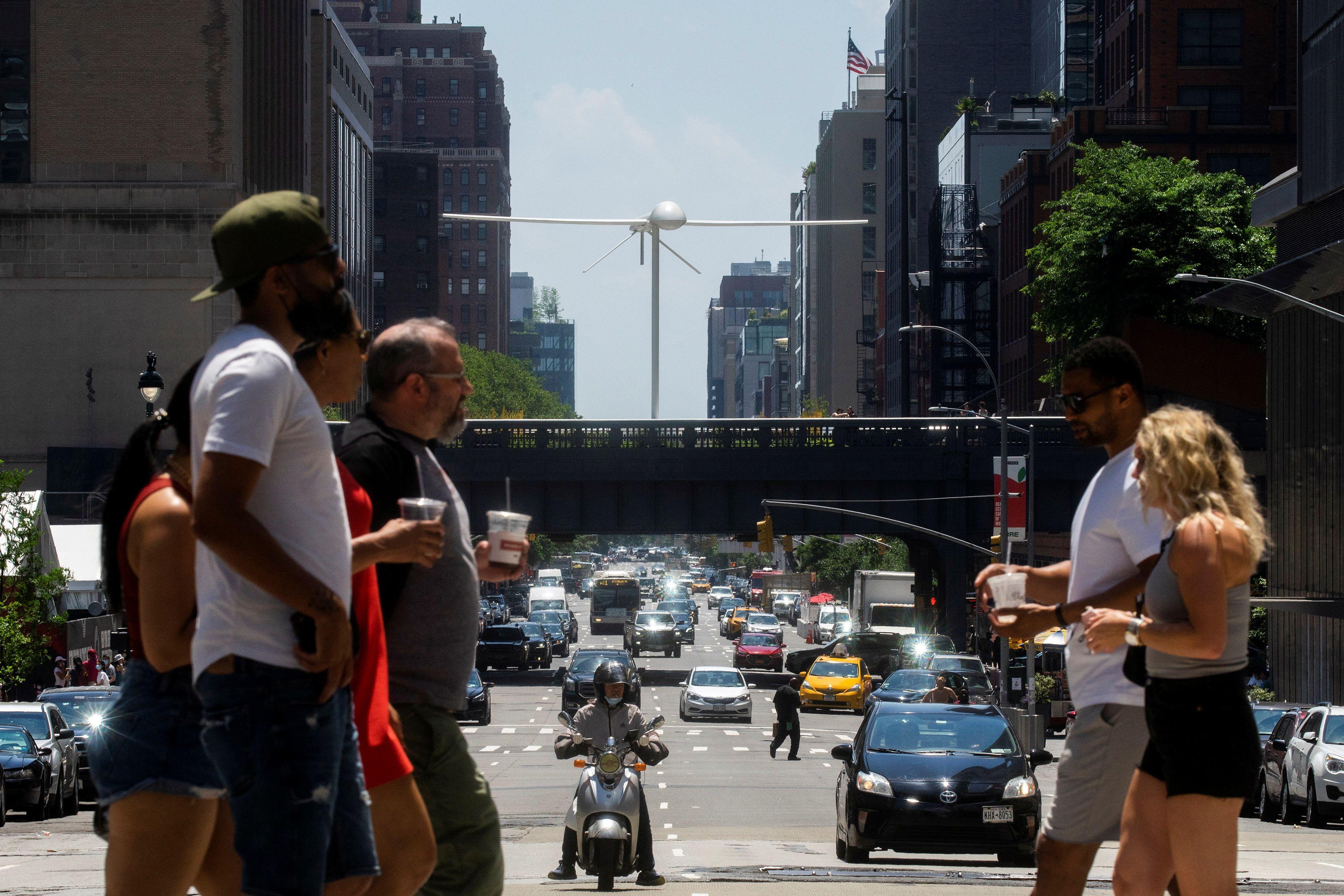 "A sculpture by artist Sam Durant called ""Untitled"" (drone), a fiberglass sculpture depicting a Predator drone, is seen over the High Line park in Manhattan borough of New York, U.S., June 6, 2021. REUTERS/Eduardo Munoz"