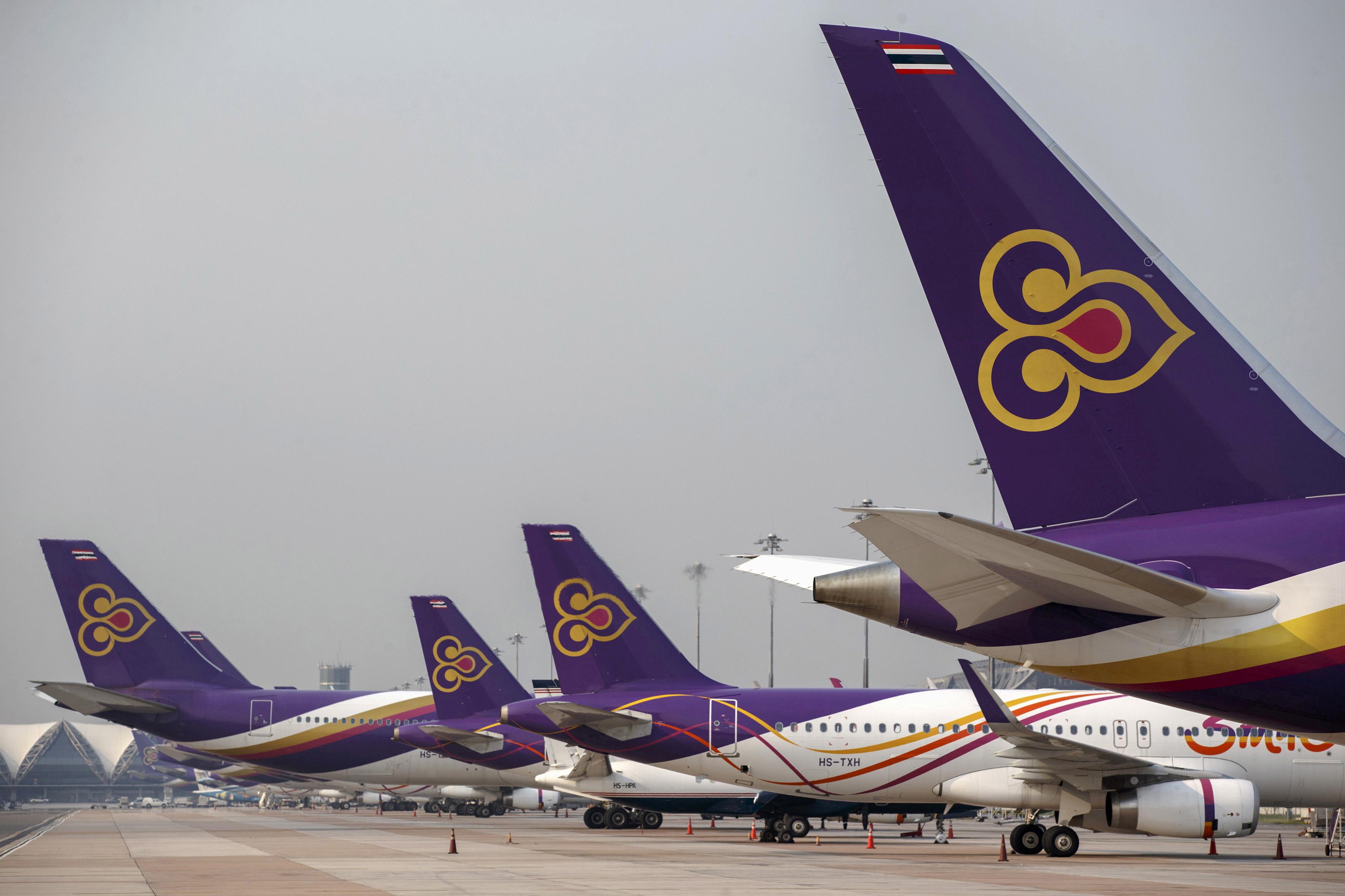 Thai Airways aircraft are parked on the tarmac at Bangkok's Suvarnabhumi International Airport March 27, 2015.  REUTERS/Athit Perawongmetha/File Photo