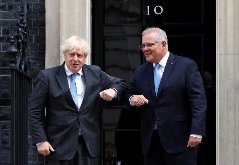 British Prime Minister Boris Johnson bumps elbows with his Australian counterpart Scott Morrison at Downing Street in London, Britain, June 15, 2021. REUTERS/Henry Nicholls