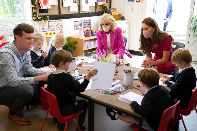 U.S. first lady Jill Biden and Britain's Catherine, Duchess of Cambridge, talk with children during a visit to Connor Downs Academy, in Hayle, Cornwall, Britain, June 11, 2021. Aaron Chown/Pool via REUTERS