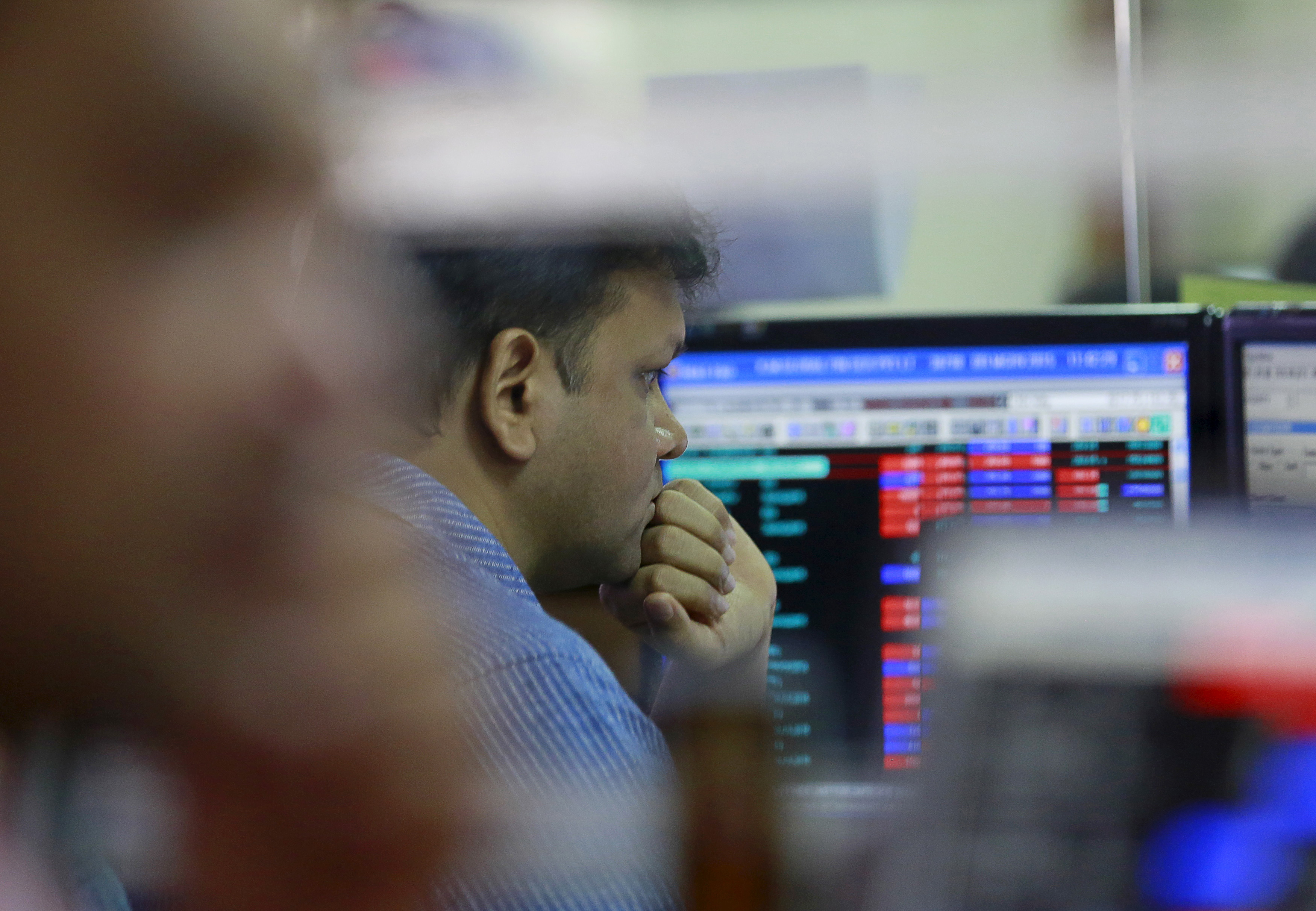 A broker reacts while trading at his computer terminal at a stock brokerage firm in Mumbai, India, June 29, 2015. REUTERS/Danish Siddiqui