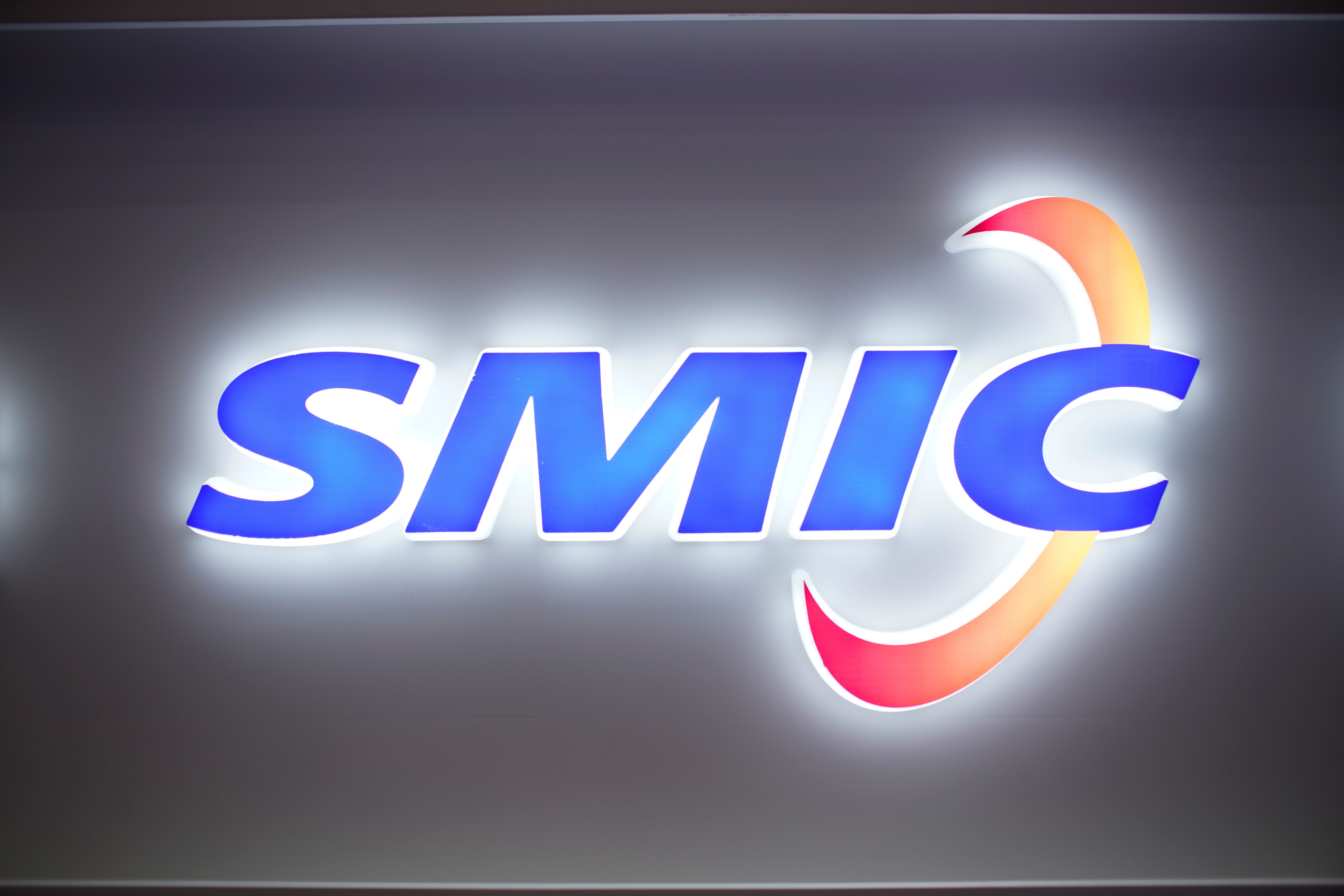 A logo of Semiconductor Manufacturing International Corporation (SMIC) is seen at China International Semiconductor Expo (IC China 2020) following the coronavirus disease (COVID-19) outbreak in Shanghai, China October 14, 2020. REUTERS/Aly Song