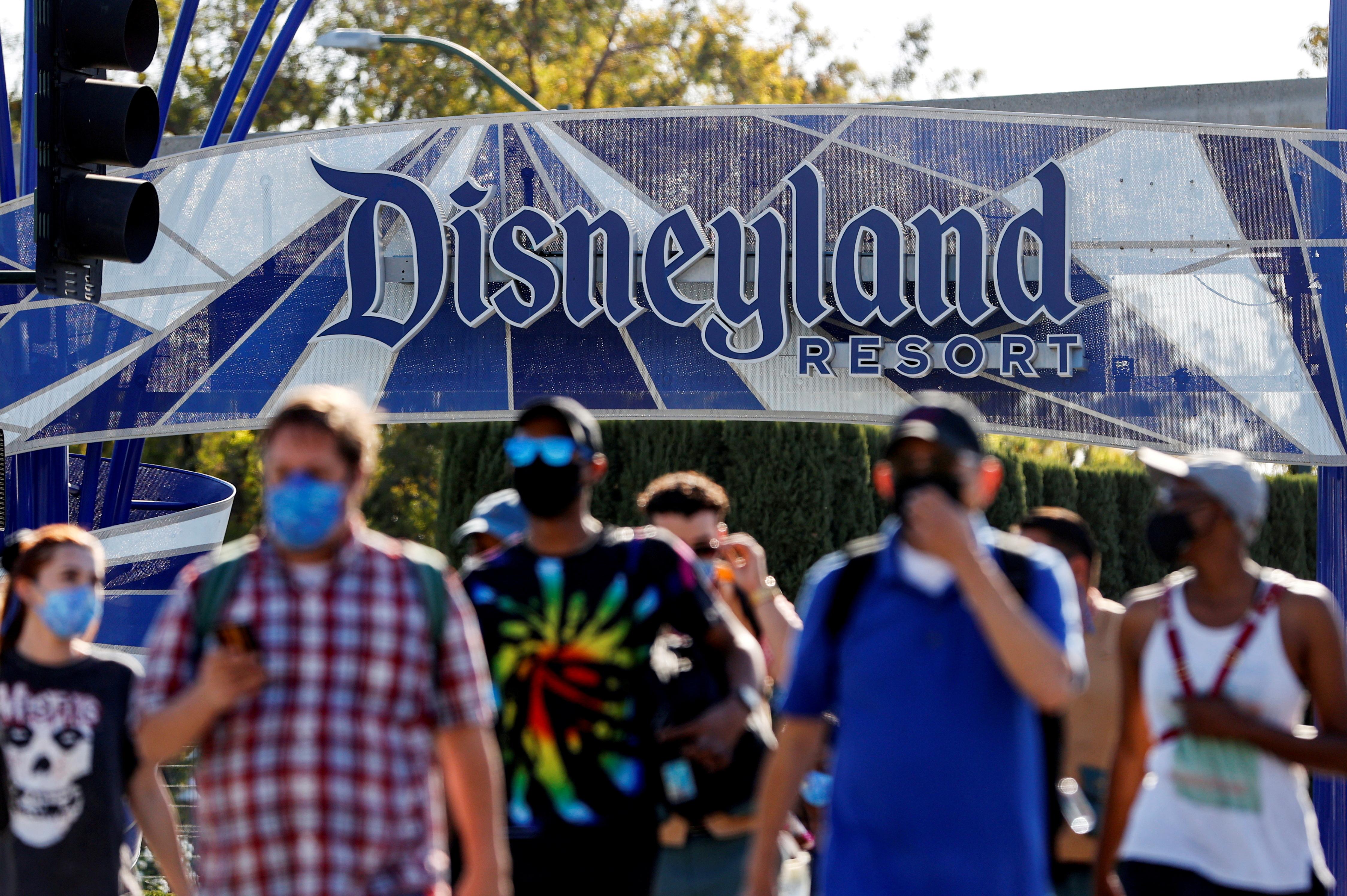 FILE PHOTO: People leave the Disneyland Resort on Disneyland Park and Disney California Adventure's reopening day amidst the coronavirus disease (COVID-19) outbreak, in Anaheim, California, U.S., April 30, 2021.  REUTERS/Mario Anzuoni