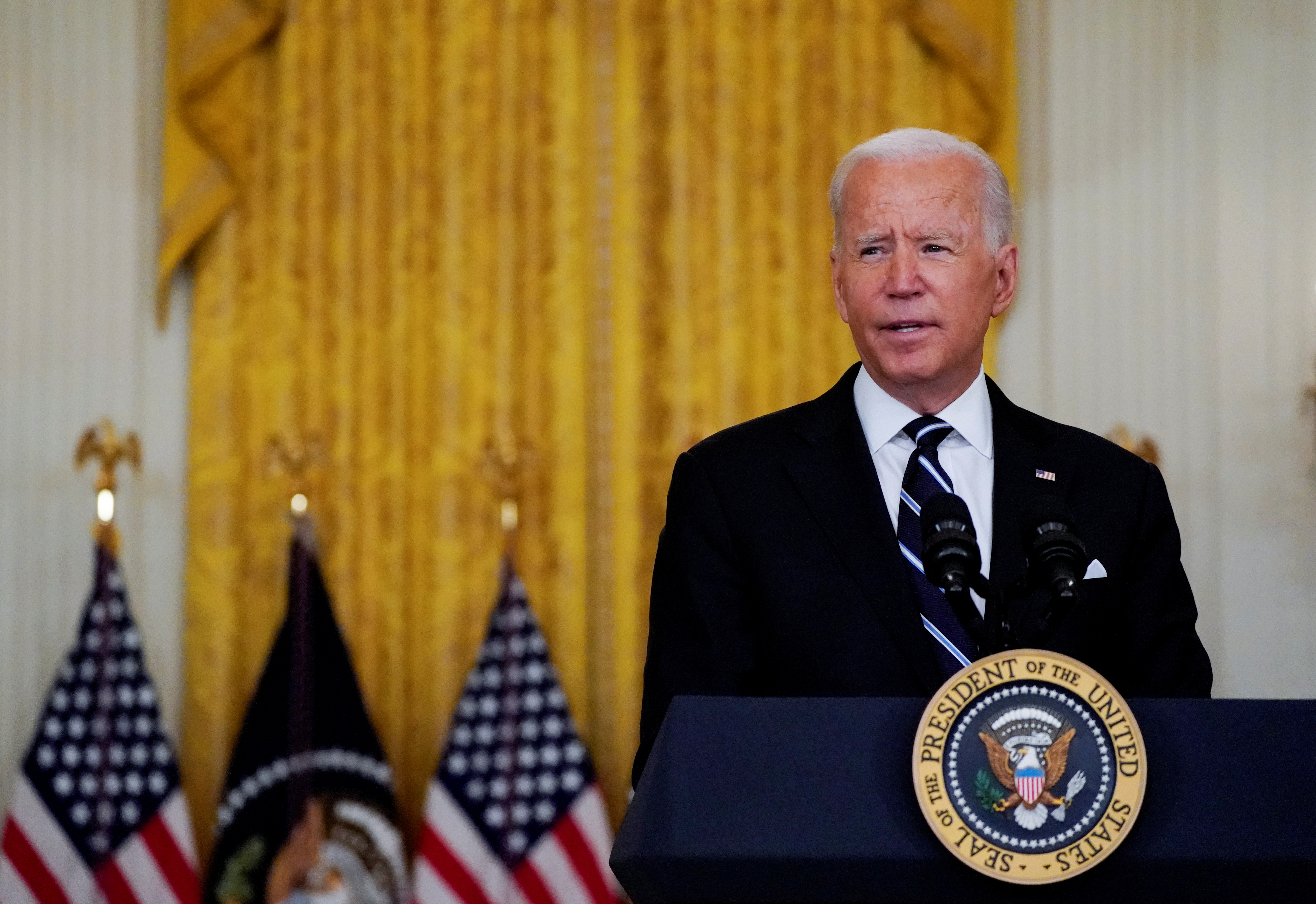 U.S. President Joe Biden delivers remarks on the coronavirus disease (COVID-19) response and  vaccination program during a speech in the East Room at the White House in Washington, U.S., August 18, 2021. REUTERS/Elizabeth Frantz