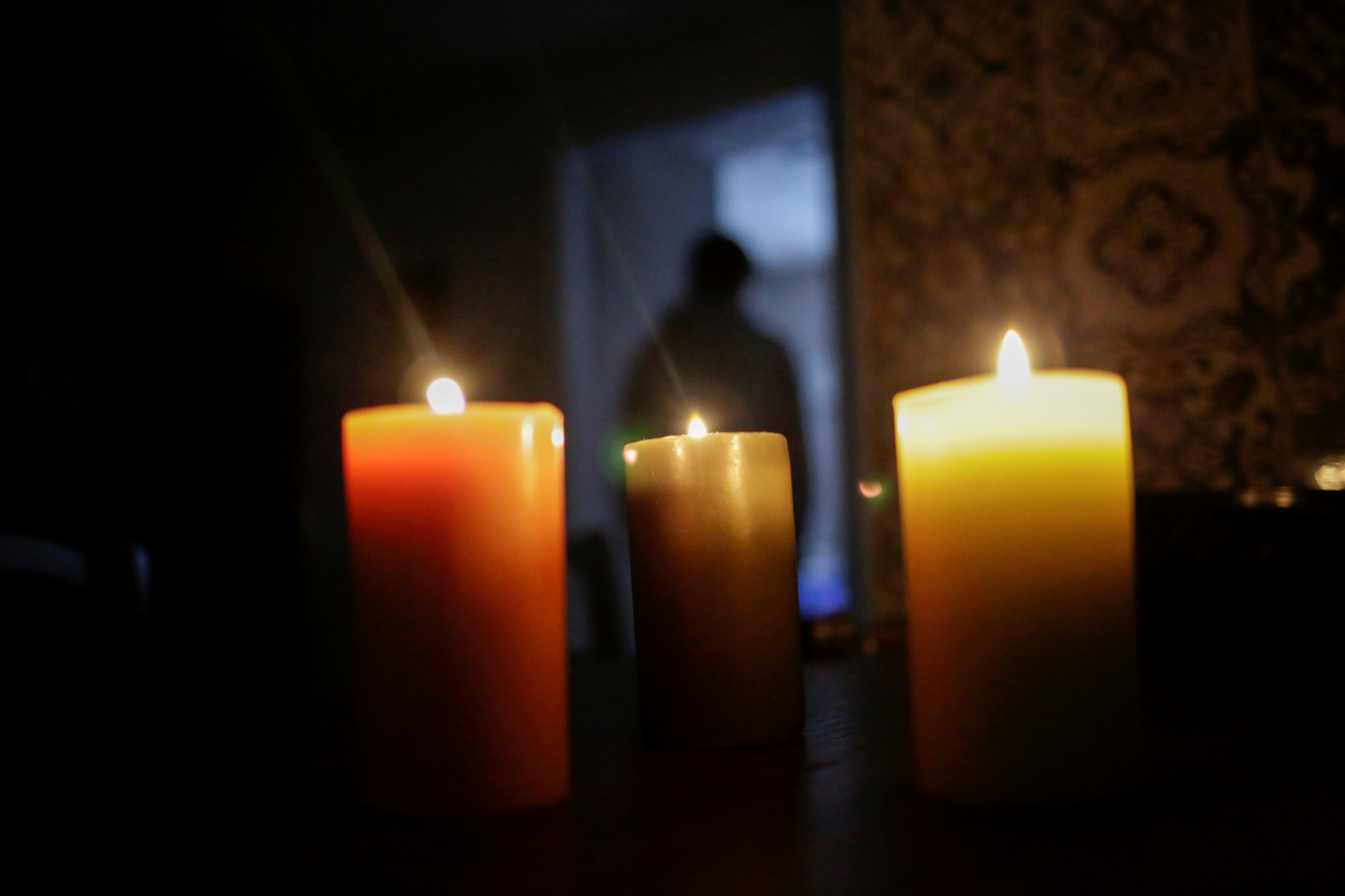 Candles are used inside a room during an outage in Mexico's electricity network, in Ciudad Juarez, Mexico February 15, 2021. REUTERS/Jose Luis Gonzalez