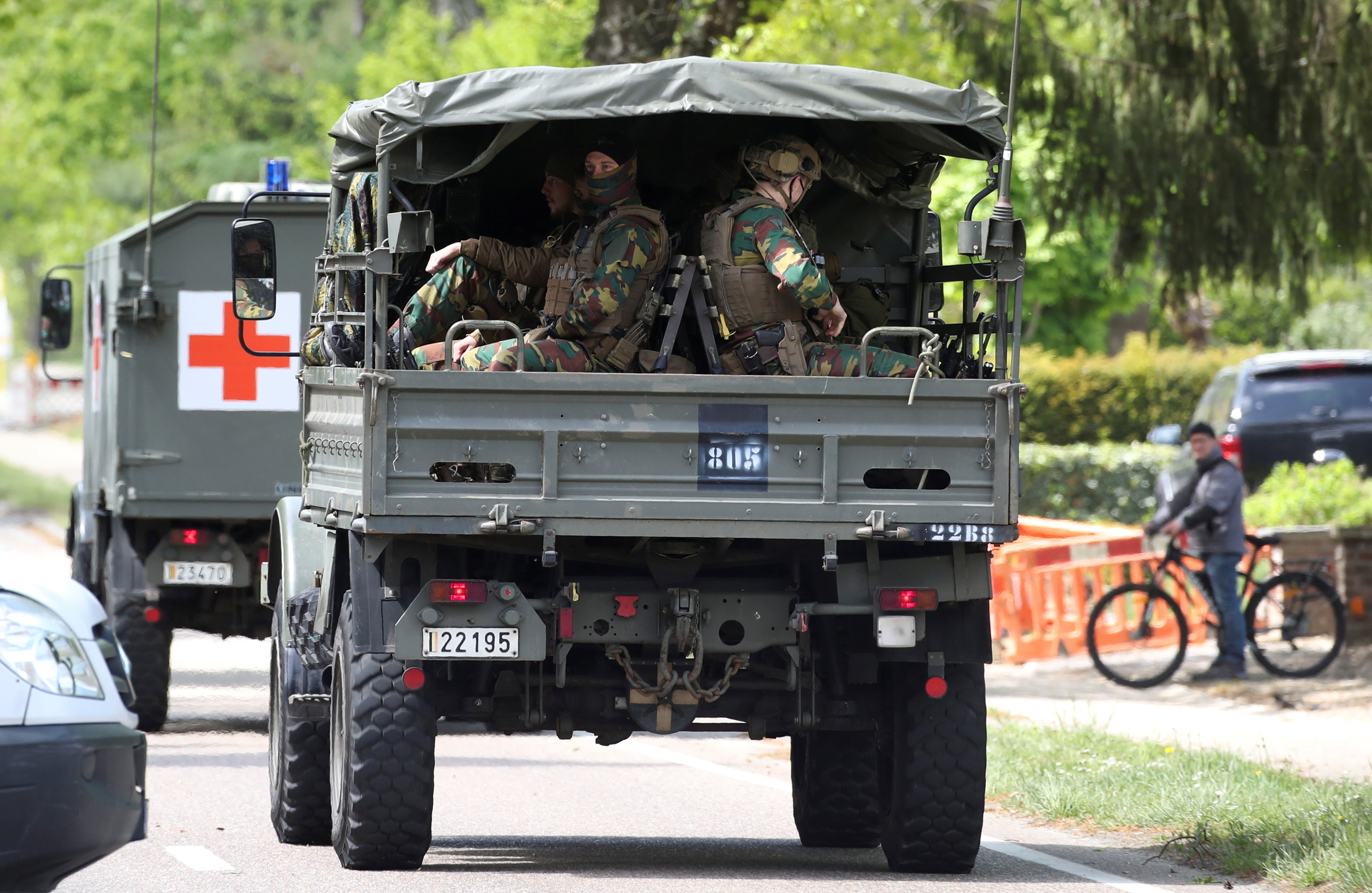 Belgian army ambulance and soldiers arrive at National Park Hoge Kempen while scouring to capture Belgian Jurgen Conings, a soldier who disappeared after threatening a virologist supportive of coronavirus disease (COVID-19) vaccines and coronavirus restrictions, in Maasmechelen, Belgium May 21, 2021. REUTERS/Yves Herman