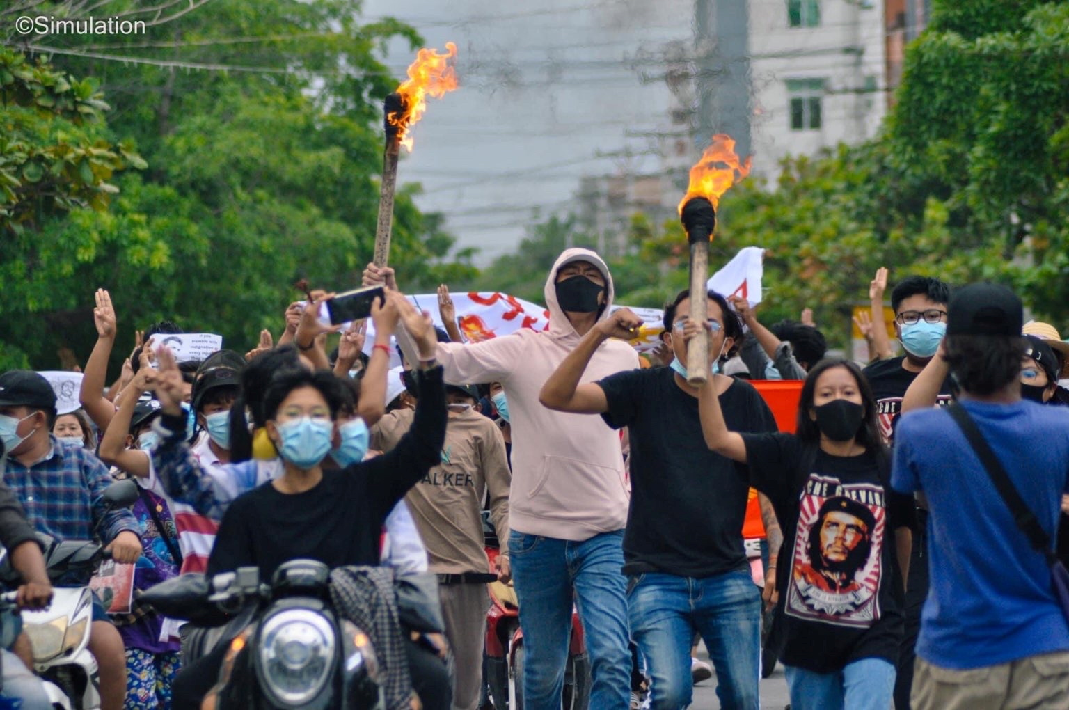 People hold torches during a protest in Mandalay, Myanmar June 14, 2021 in this picture obtained by REUTERS. ATTENTION EDITORS - THIS IMAGE HAS BEEN SUPPLIED BY A THIRD PARTY. NO RESALES. NO ARCHIVES.