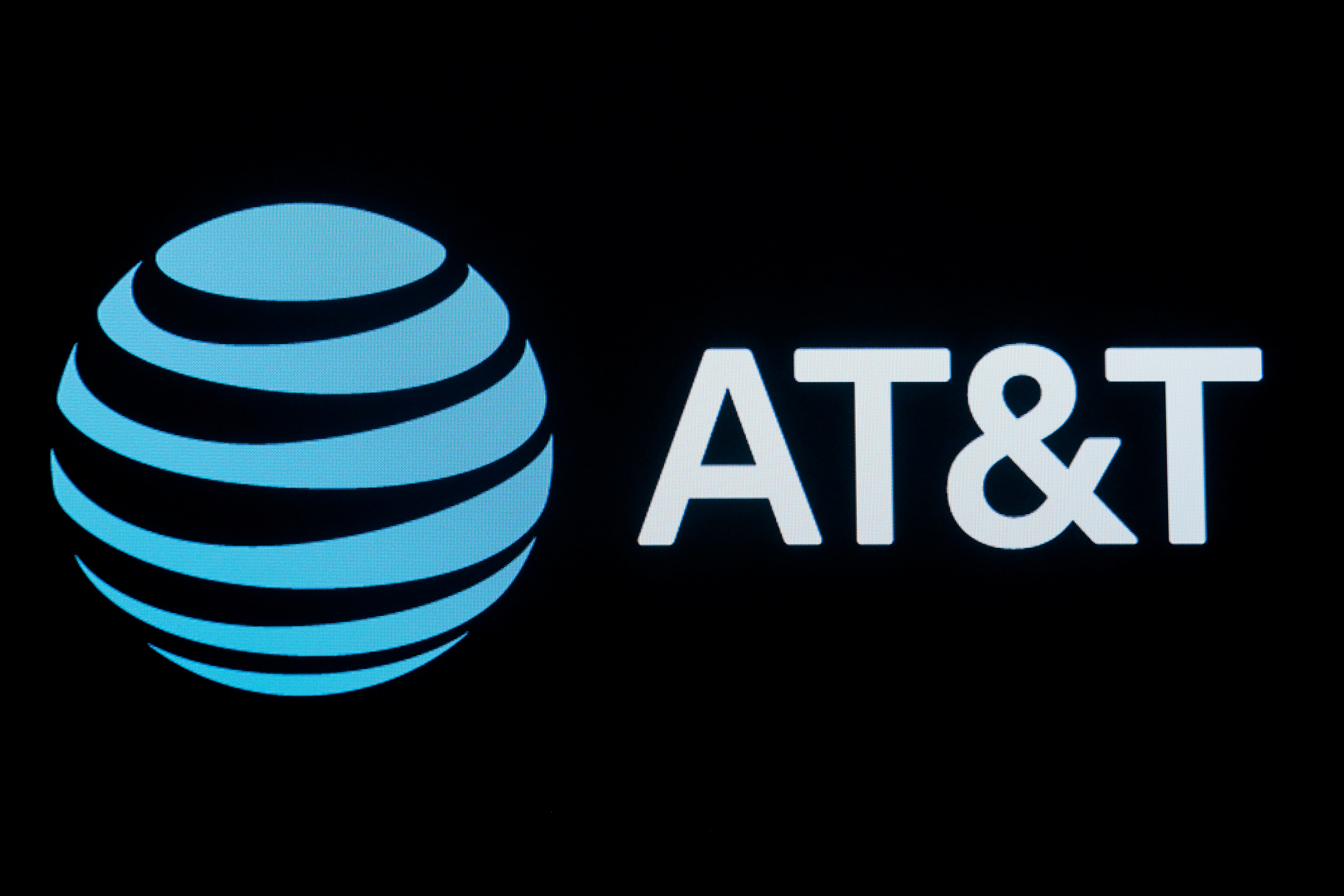 The company logo for AT&T is displayed on a screen on the floor at the New York Stock Exchange (NYSE) in New York, September 18, 2019. REUTERS/Brendan McDermid