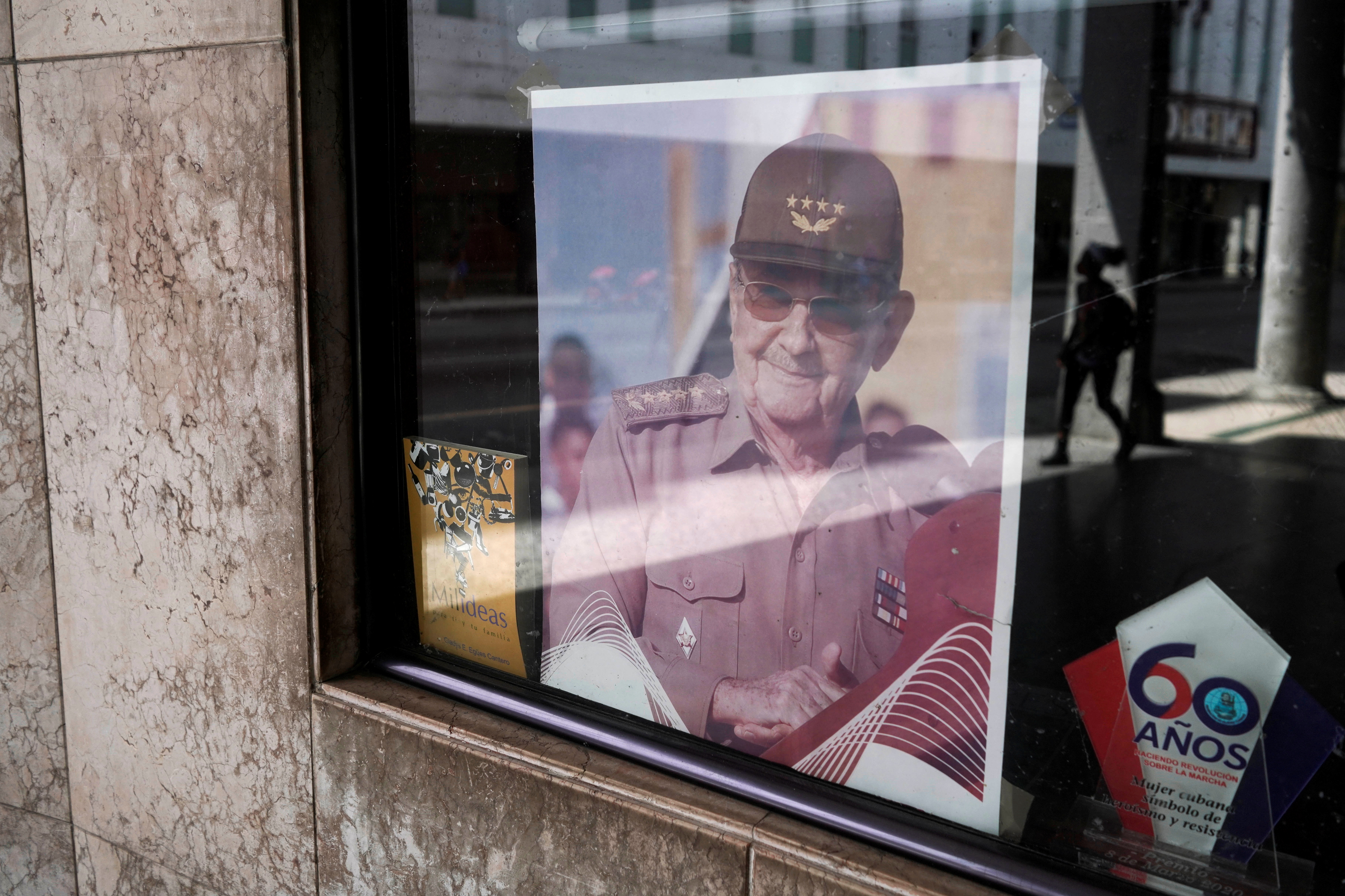 A picture of former Cuban President Raul Castro is displayed in the window of a state building in Havana, Cuba, April 11, 2021.   REUTERS/Alexandre Meneghini