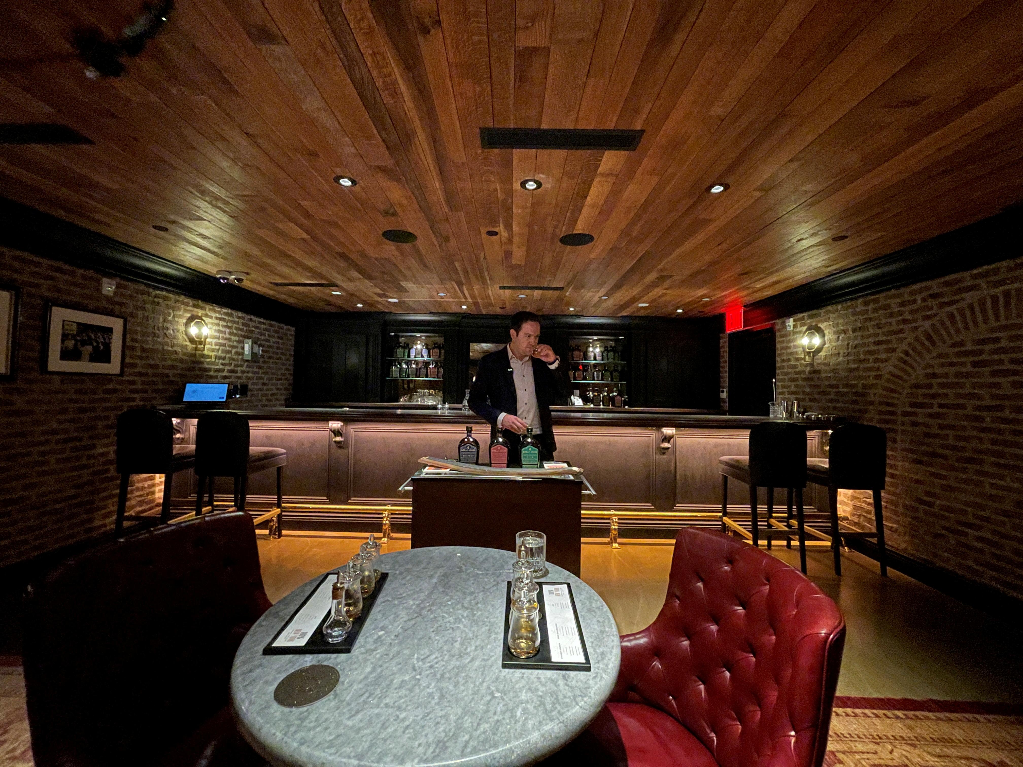 Andrew Merinoff, Great Jones Distilling Co. project manager, stands inside the distillery's speakeasy in New York, NY, U.S., September 16, 2021. Picture taken September 16, 2021. REUTERS/Roselle Chen