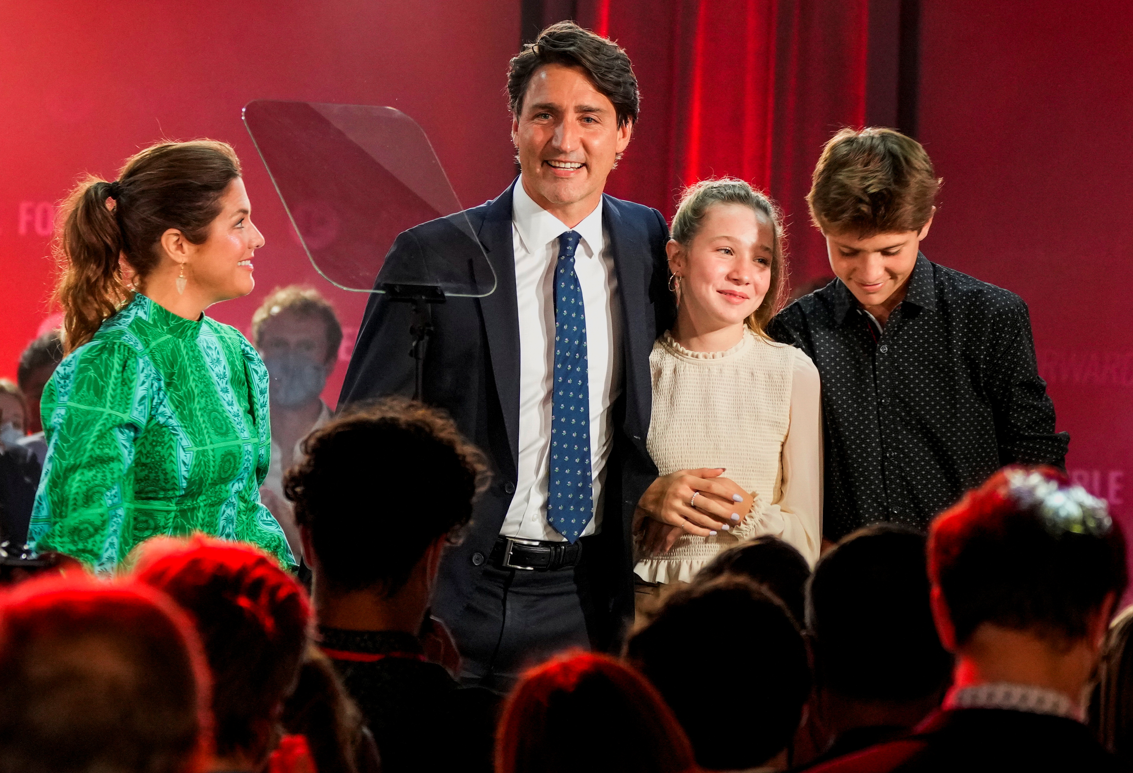 Canada's Liberal Prime Minister Justin Trudeau, accompanied by his wife Sophie Gregoire and their children Ella-Grace and Xavier, reacts during the Liberal election night party in Montreal, Quebec, Canada, September 21, 2021. REUTERS/Carlos Osorio