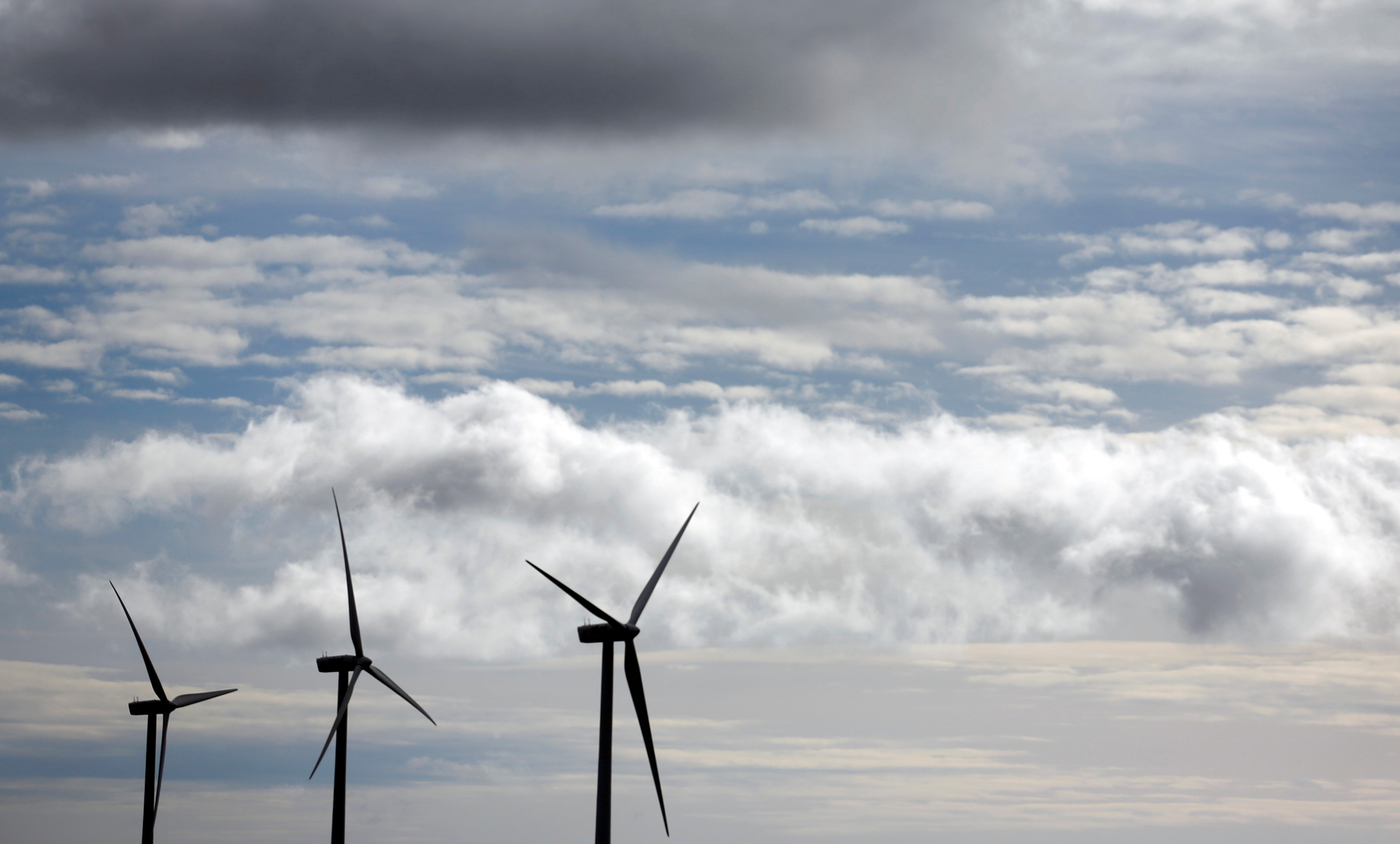 Iberdrola's power generating wind turbines are seen against cloudy sky at Moranchon wind farm in central Spain December 17, 2012.   REUTERS/Sergio Perez