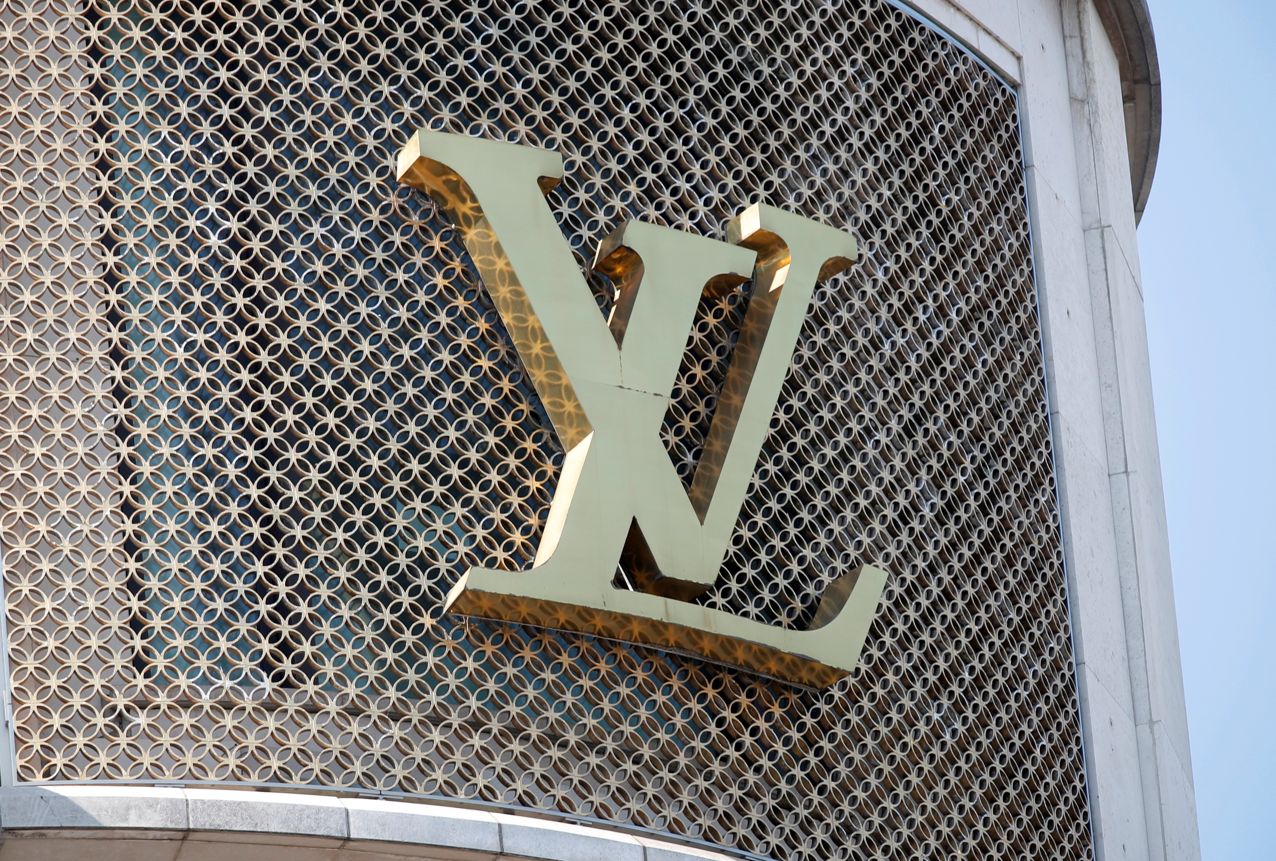 A Louis Vuitton logo is seen outside a store on the Champs-Elysees in Paris, France, September 18, 2020.   REUTERS/Charles Platiau/File Photo