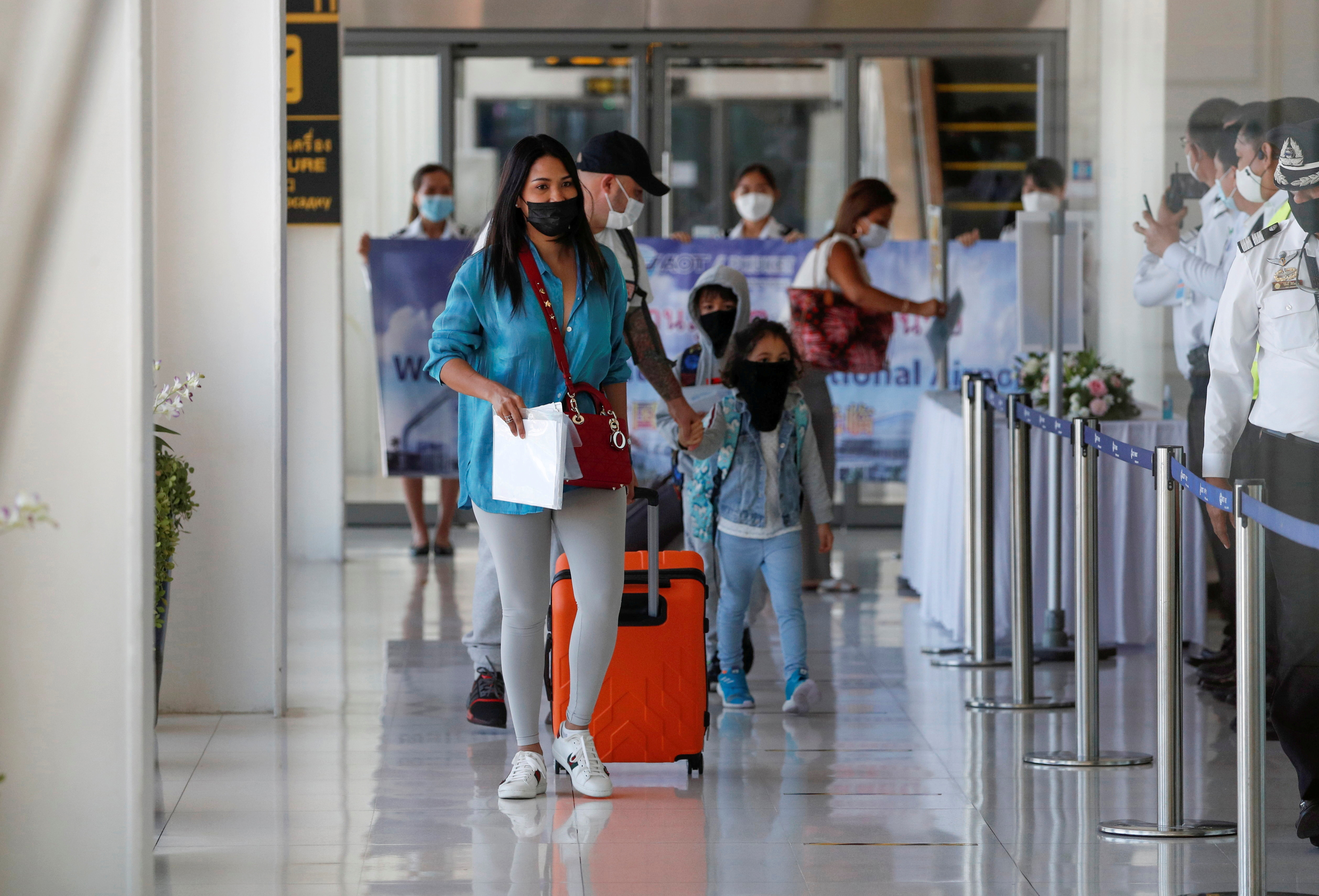 The first foreign tourists arrive at the airport as Phuket reopens to overseas tourists, allowing foreigners fully vaccinated against the coronavirus disease (COVID-19) to visit the resort island without quarantine, in Phuket, Thailand July 1, 2021. REUTERS/Jorge Silva  REFILE - REMOVING EXTRA SENTENCE