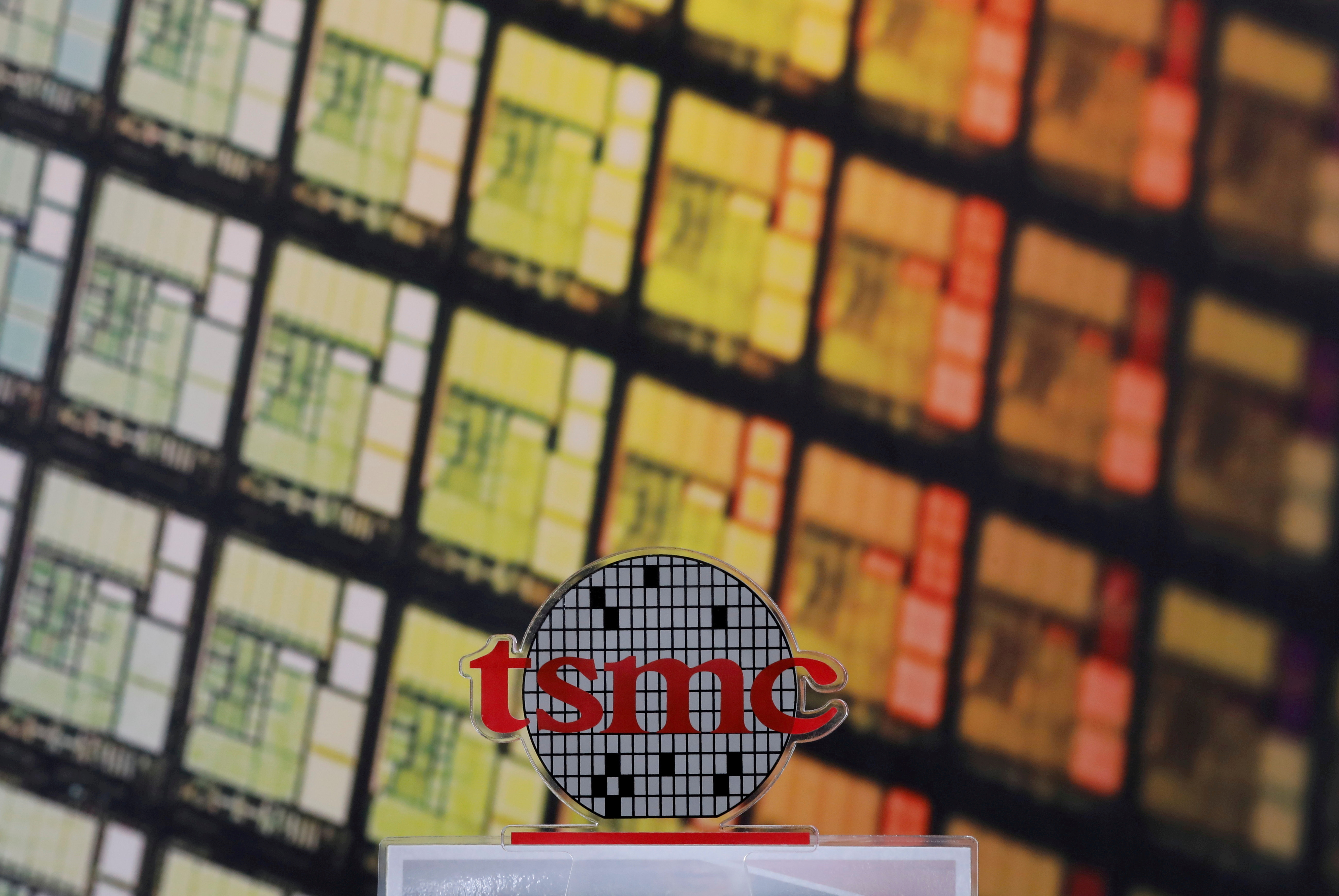 FILE PHOTO: A logo of Taiwan Semiconductor Manufacturing Co (TSMC) is seen at its headquarters in Hsinchu, Taiwan August 31, 2018.  REUTERS/Tyrone Siu