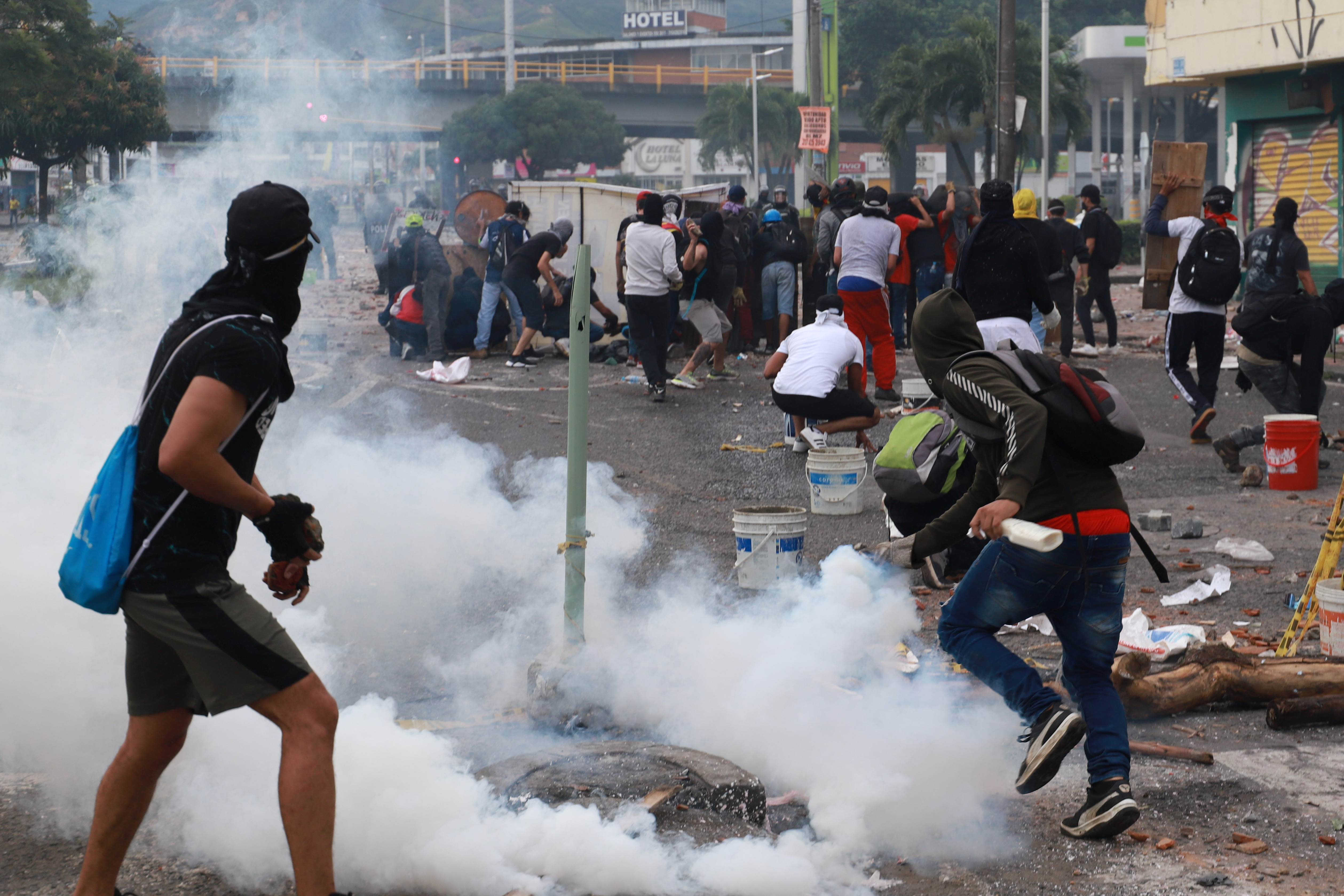 Demonstrators clash with members of the security forces during a protest against what they say was police brutality exerted in recent protests against President Ivan Duque's government's tax reform in Cali, Colombia May 3, 2021. REUTERS/Juan Bautista