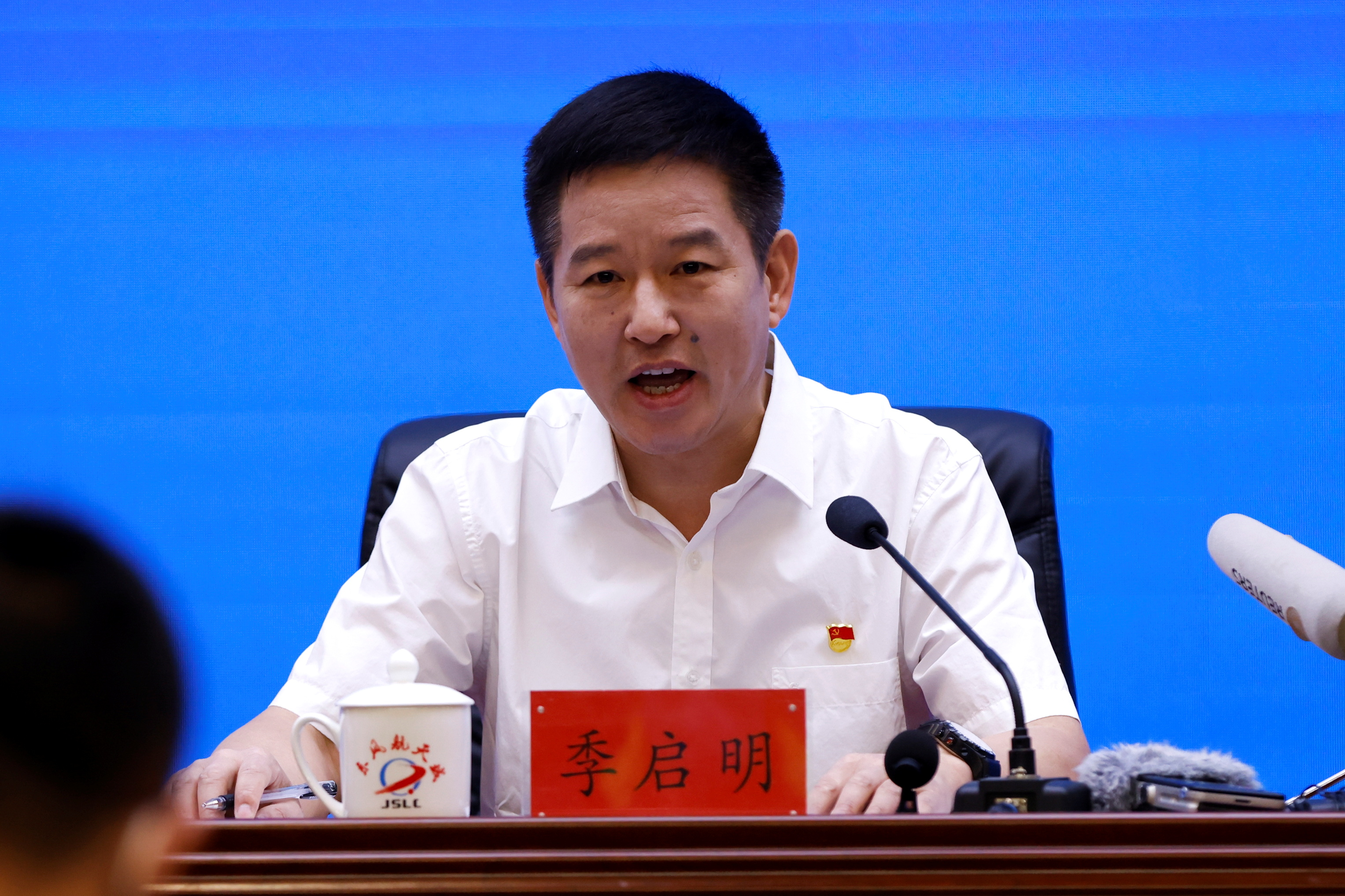 Ji Qiming, Assistant Director General of China Manned Space Agency speaks during a news conference before the Shenzhou-12 mission to build China's space station, at Jiuquan Satellite Launch Center in Gansu province, China June 16, 2021. REUTERS/Carlos Garcia Rawlins