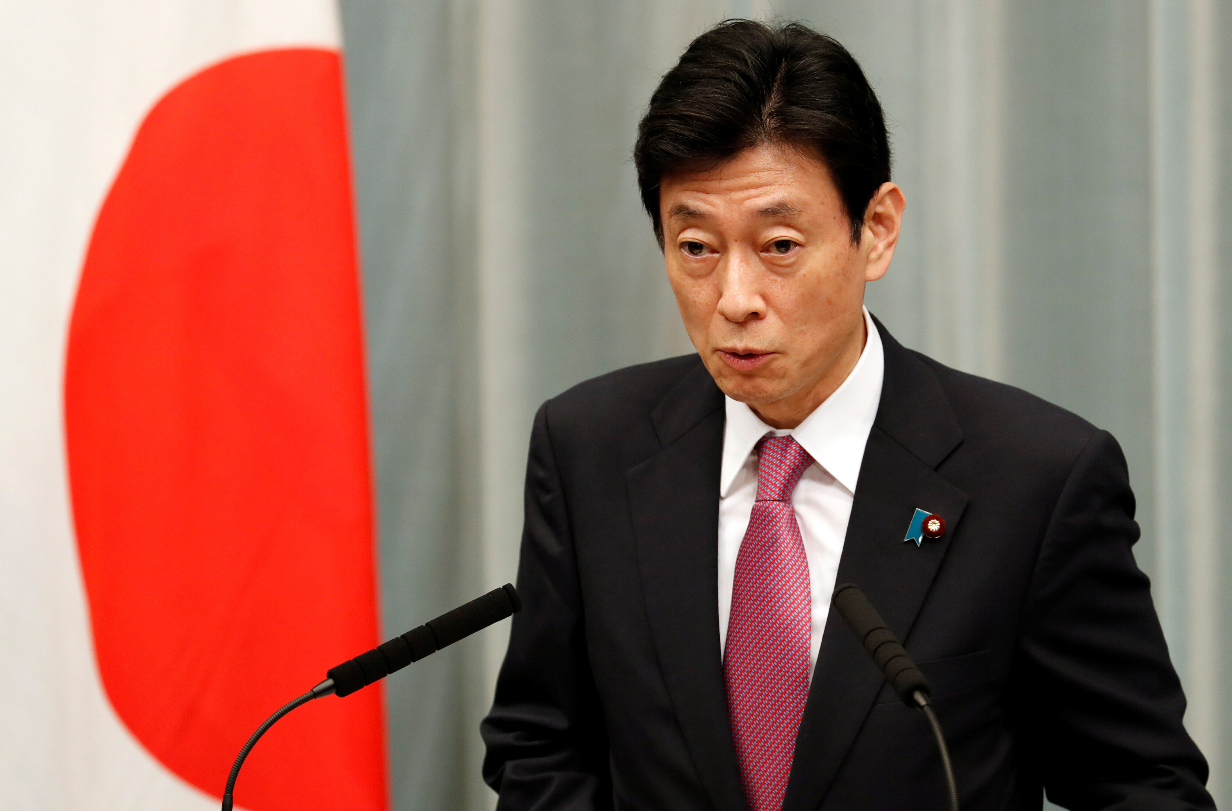 Japan's Minister in charge of economic revitalisation and measures for the novel coronavirus pandemic Yasutoshi Nishimura attends a news conference in Tokyo, Japan, September 16, 2020. REUTERS/Kim Kyung-Hoon