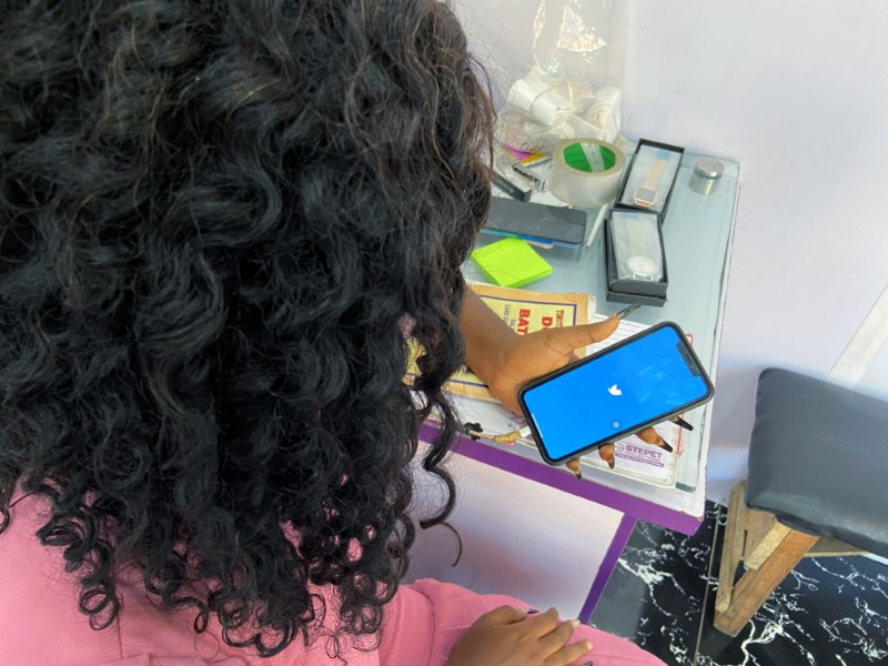 Lagos based entreprenuer Ogechi Egemonu opens the Twitter app on a smart phone at her office in Lagos, Nigeria June 10, 2021.  REUTERS/Seun Sanni