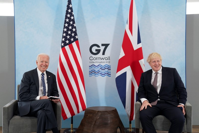 Britain's Prime Minister Boris Johnson and U.S. President Joe Biden look on during their meeting, ahead of the G7 summit, at Carbis Bay, Cornwall, Britain June 10, 2021REUTERS/Kevin Lamarque