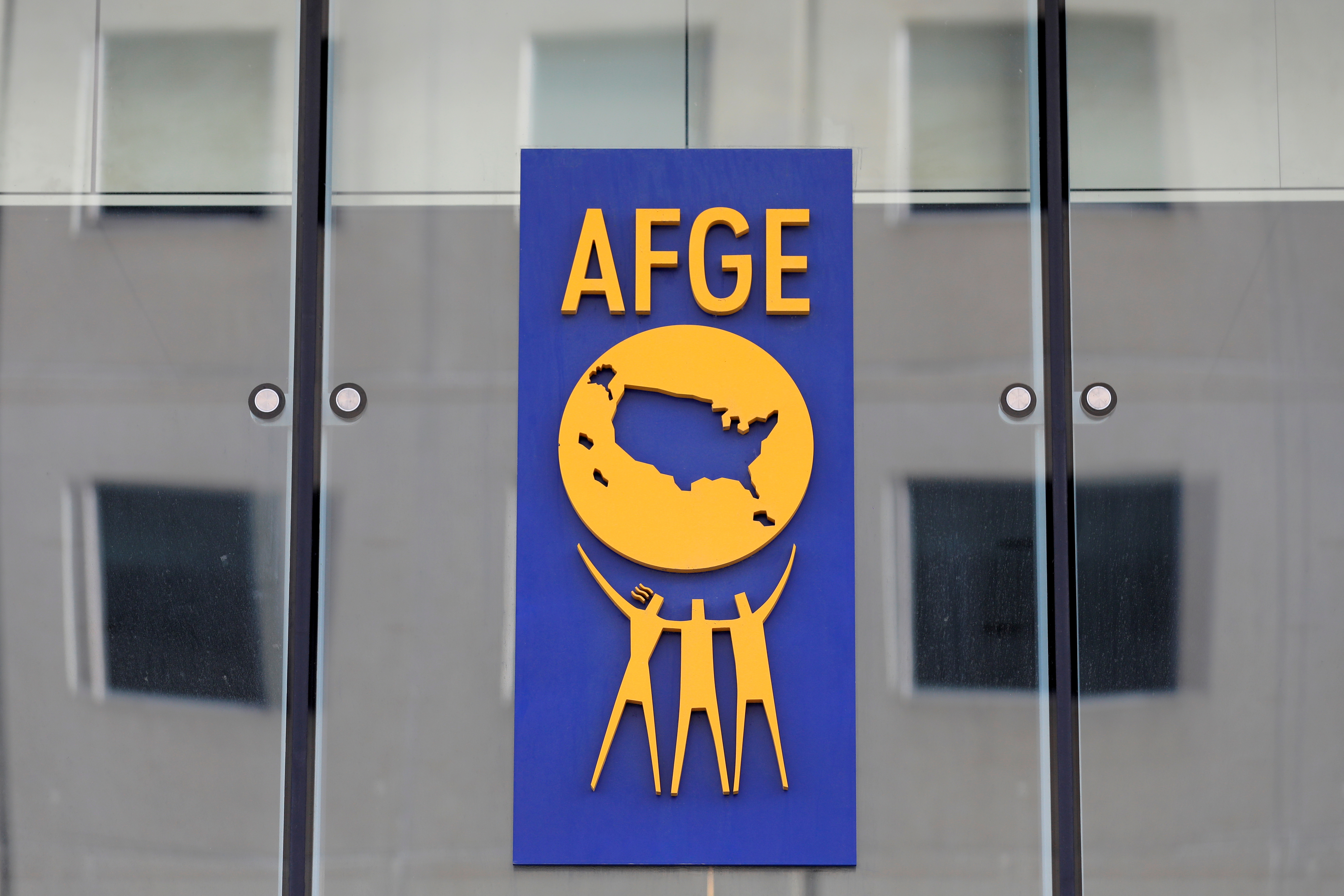 The logo of the American Federation of Government Employees (AFGE) is seen on the outside of their headquarters in Washington, D.C., U.S., August 30, 2020. REUTERS/Andrew Kelly/File Photo