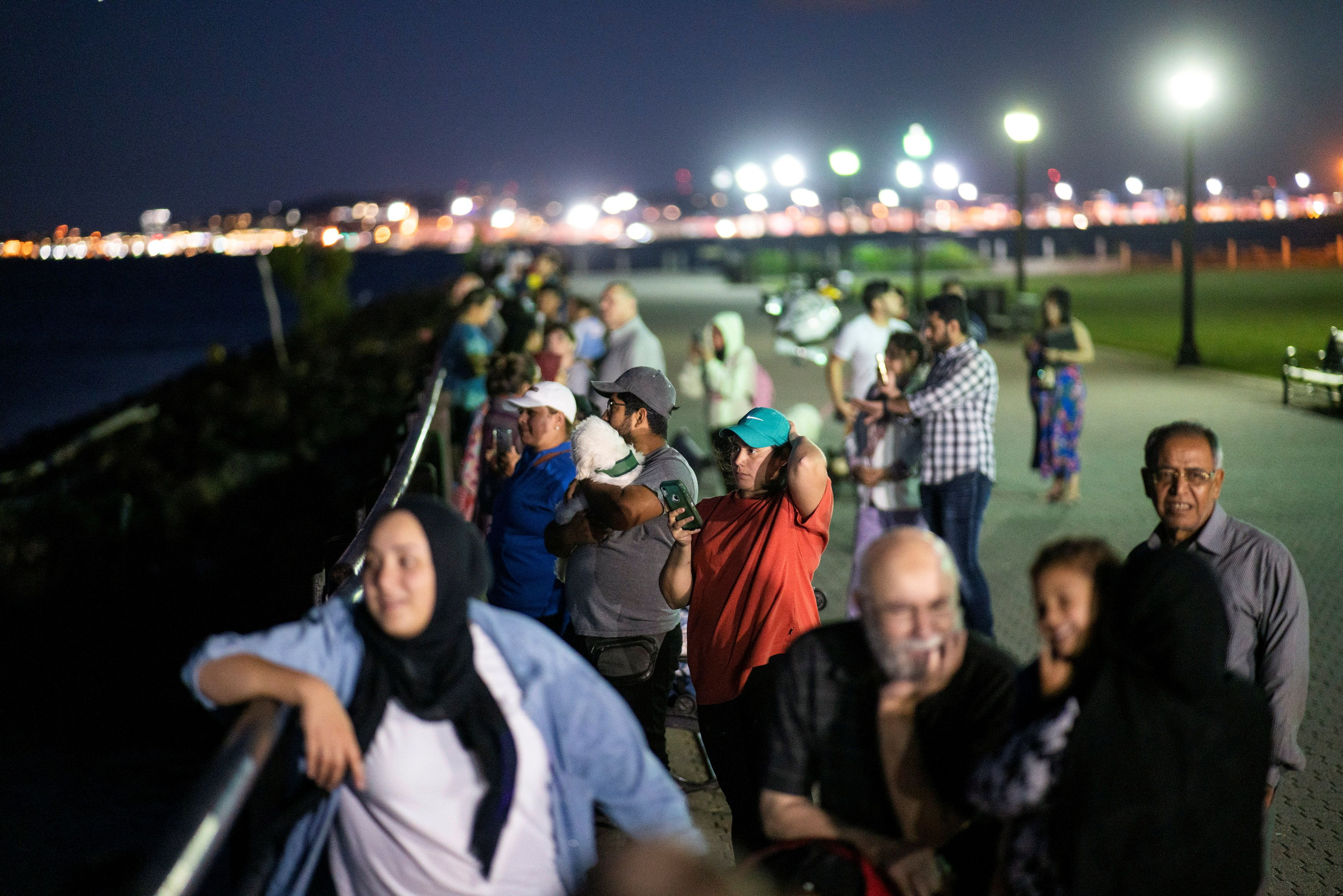 People watch fireworks in the New York City Harbor, as New York State celebrates reaching a 70 percent vaccination threshold for the coronavirus disease (COVID-19), as seen from Jersey City, New Jersey, U.S., June 15, 2021. REUTERS/Eduardo Munoz