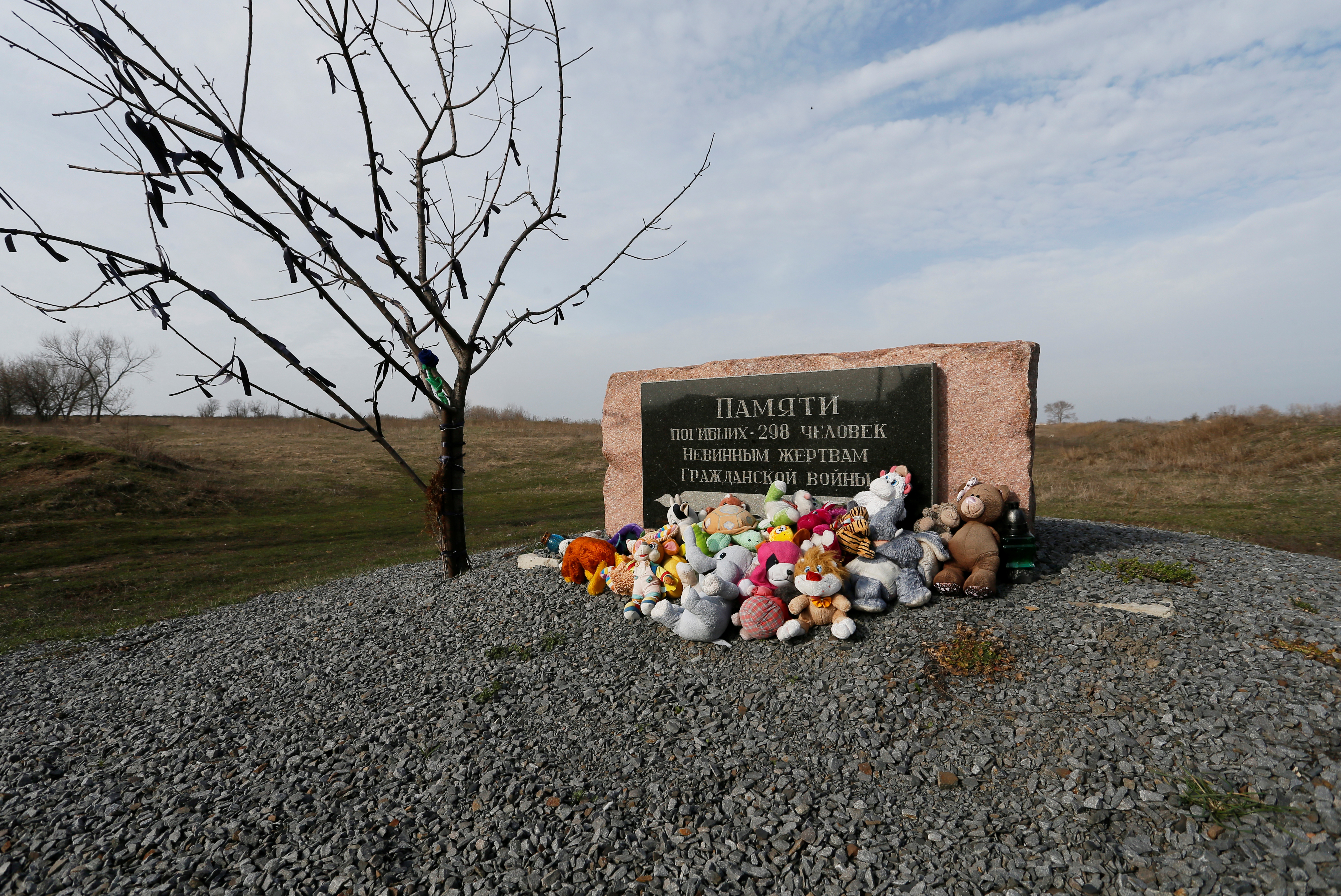 Toys are placed at a memorial to victims of Malaysia Airlines Flight MH17 plane crash near the village of Hrabove in Donetsk region, Ukraine March 9, 2020. REUTERS/Alexander Ermochenko