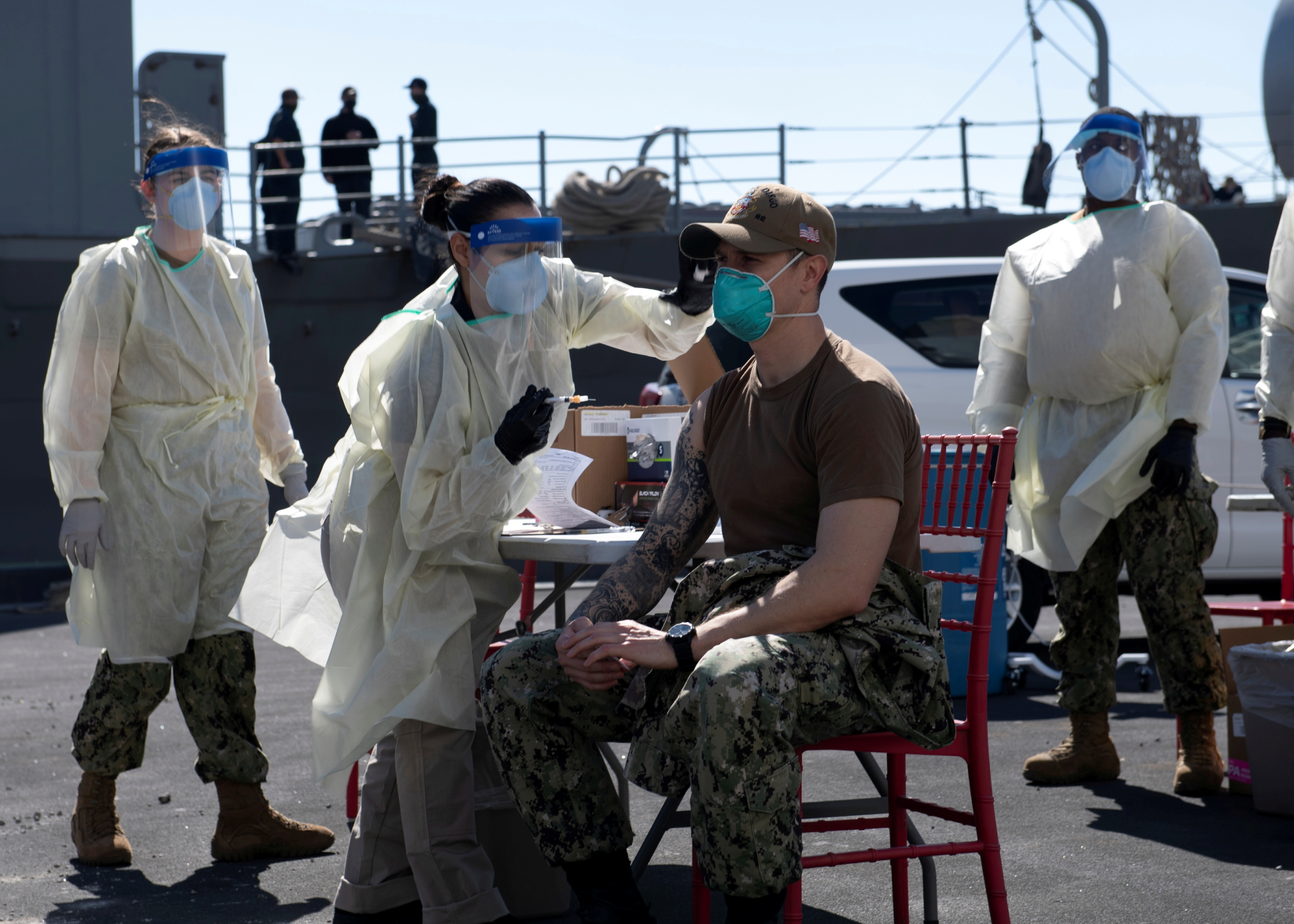 A United States Navy officer from the amphibious ship USS San Diego (LPD 22) receives a vaccine against Coronavirus (COVID-19) at the navy port in Manama, Bahrain in this picture taken February 26, 2021 and released by U.S Navy on February 27, 2021. Brandon Woods/U.S. Navy/Handout via REUTERS/File Photo