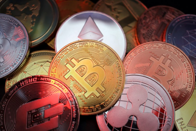 Representations of cryptocurrencies including Bitcoin, Dash, Ethereum, Ripple and Litecoin are seen in this illustration picture taken June 2, 2021. REUTERS/Florence Lo/Illustration/File Photo