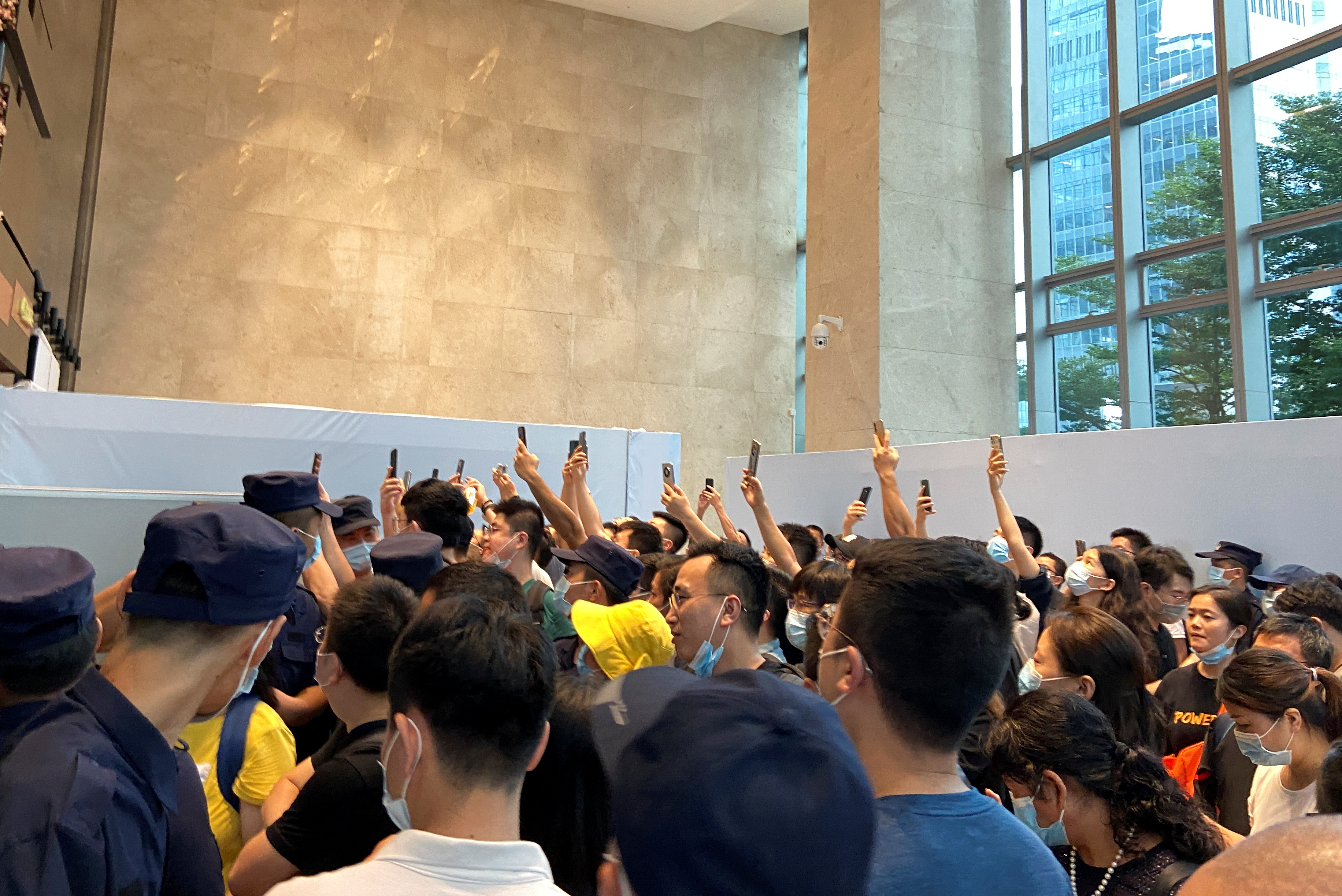 People gather to demand repayment of loans and financial products at the Evergrande's headquarters, in Shenzhen, Guangdong province, China September 13, 2021. REUTERS/David Kirton
