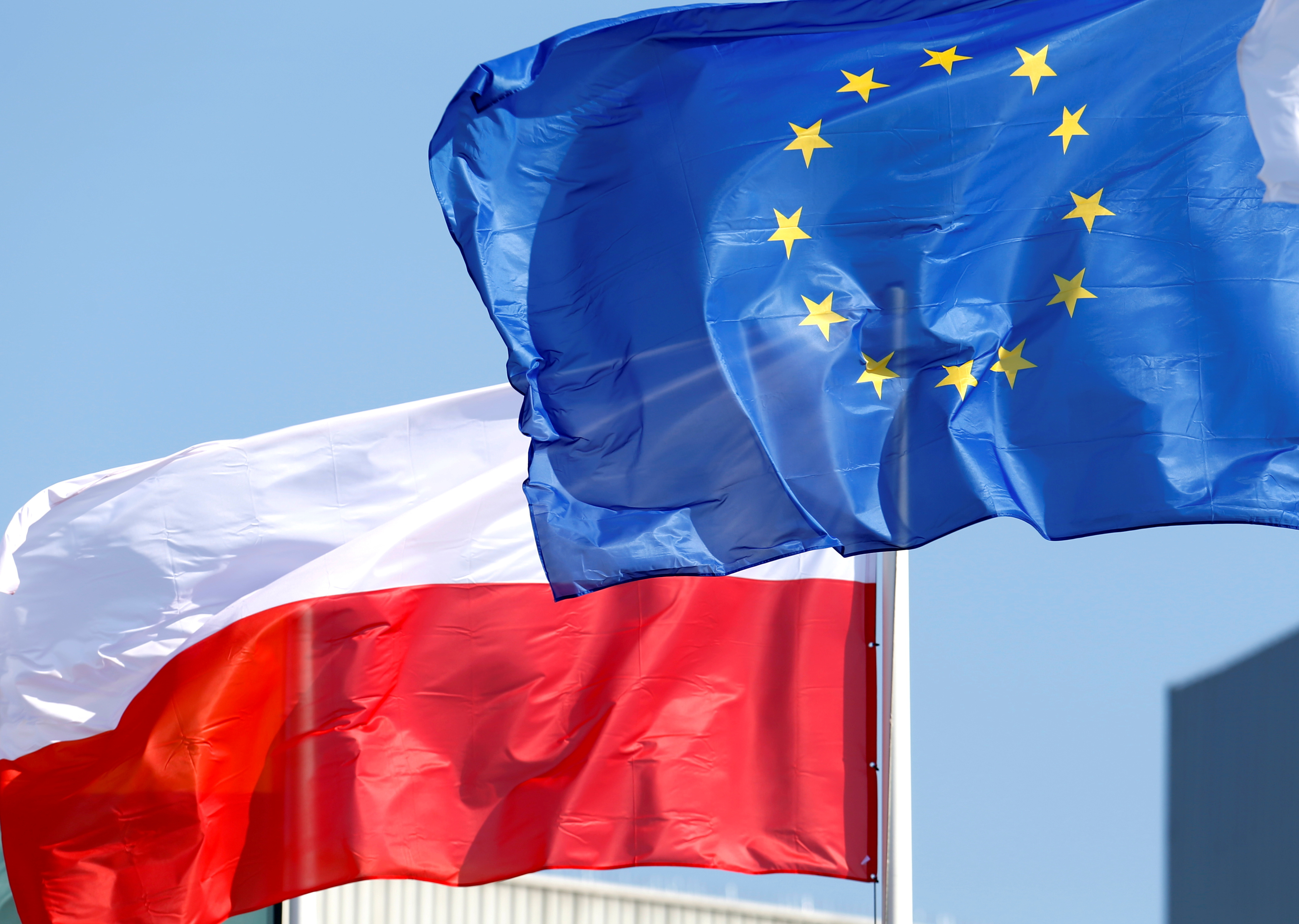 European Union and Polish flags flutter at the Orlen refinery in Mazeikiai, Lithuania April 5, 2019. REUTERS/Ints Kalnins/File Photo