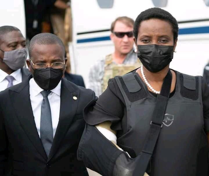 Haiti's interim Prime Minister Claude Jospeh walks with the Haiti's first lady Martine Moise, the wife of assassinated President Jovenel Moise, after she arrives from the U.S, in Port-au-Prince, Haiti, in this undated photograph obtained by Reuters on July 17, 2021. Prime Minister's Office/Handout via REUTERS