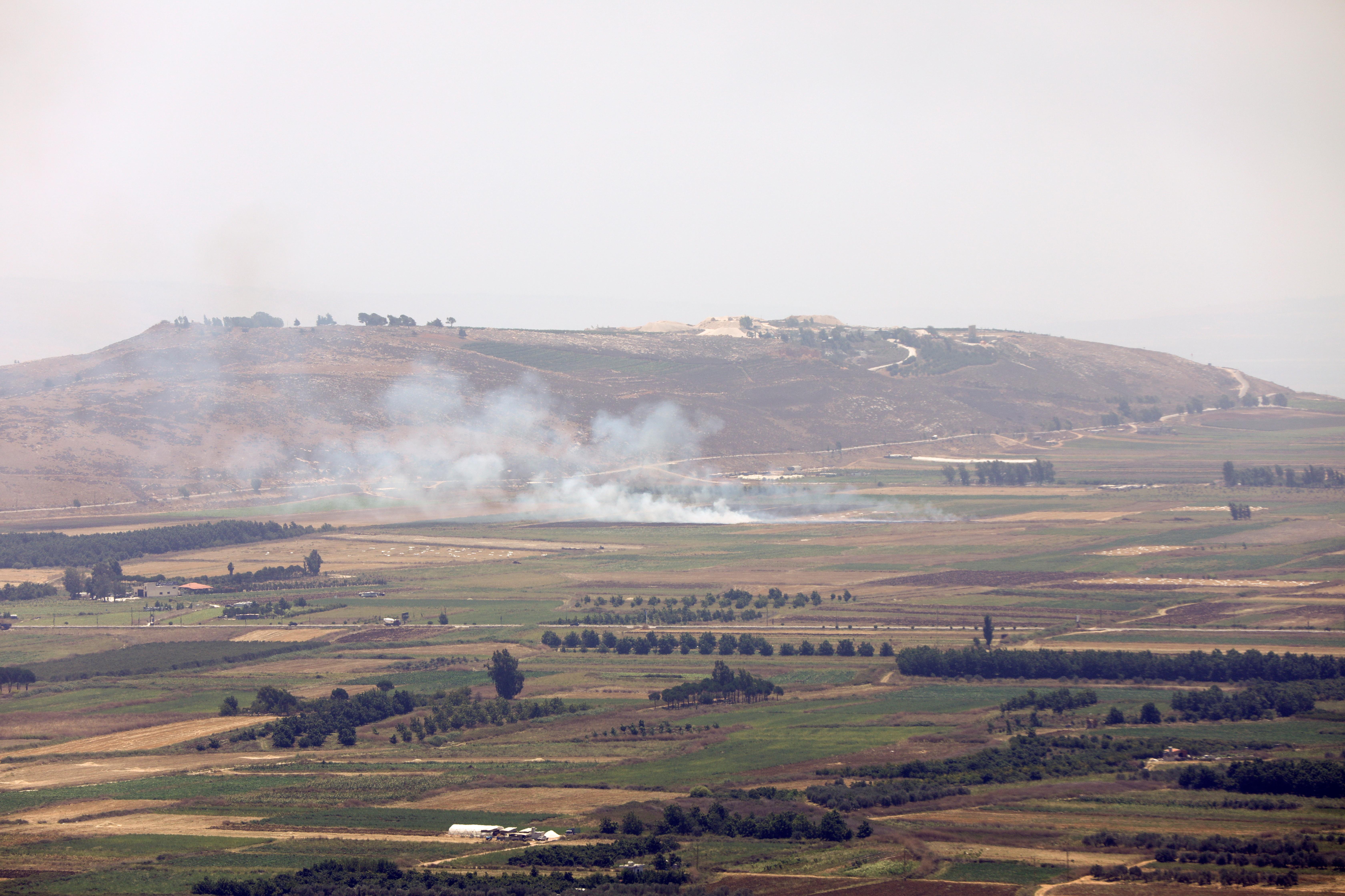 Smoke rises as seen from Marjayoun, near the border with Israel, Lebanon August 4, 2021. REUTERS/Karamallah Daher